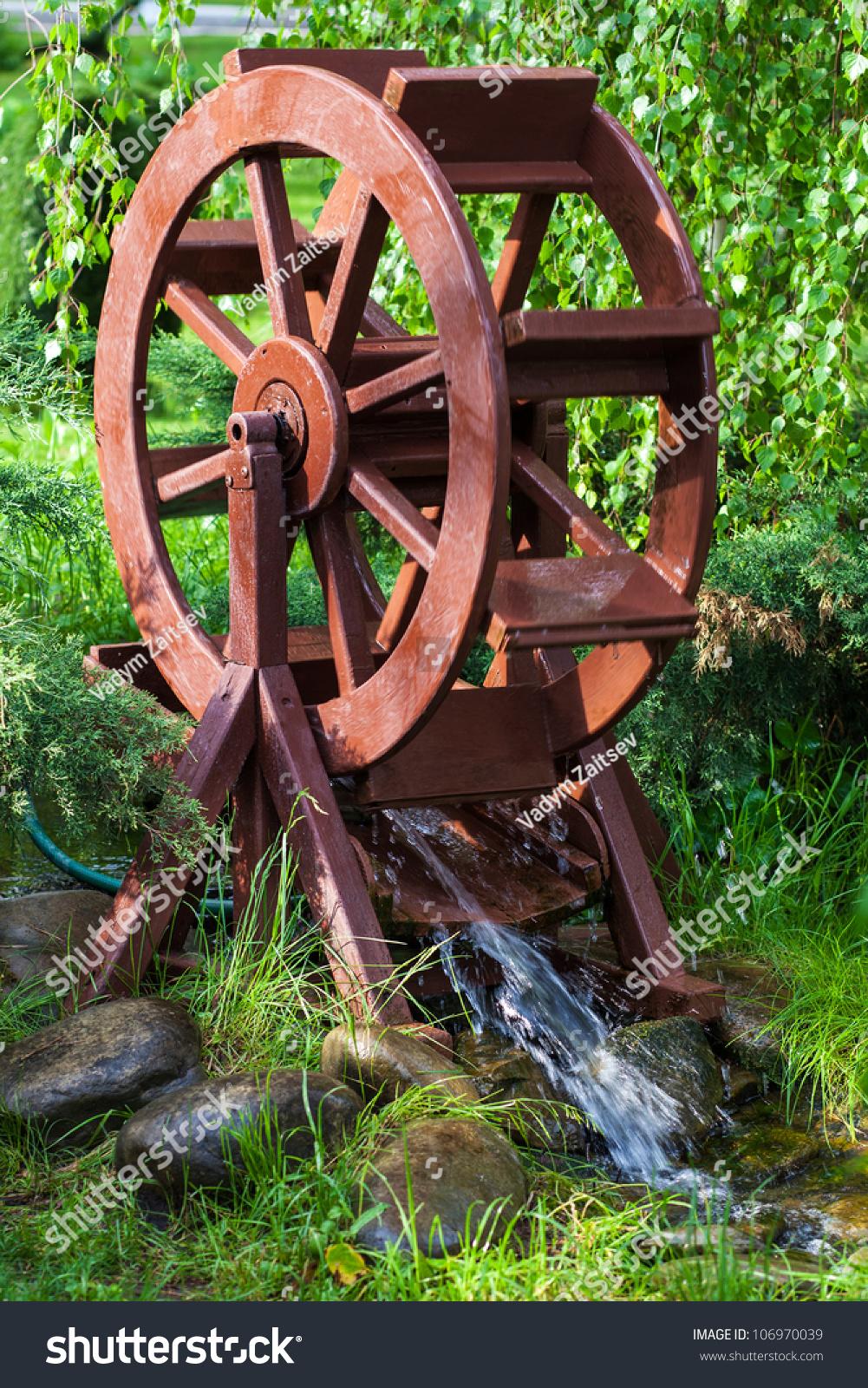 Decorative water wheel garden element modern stock photo for Element landscape design