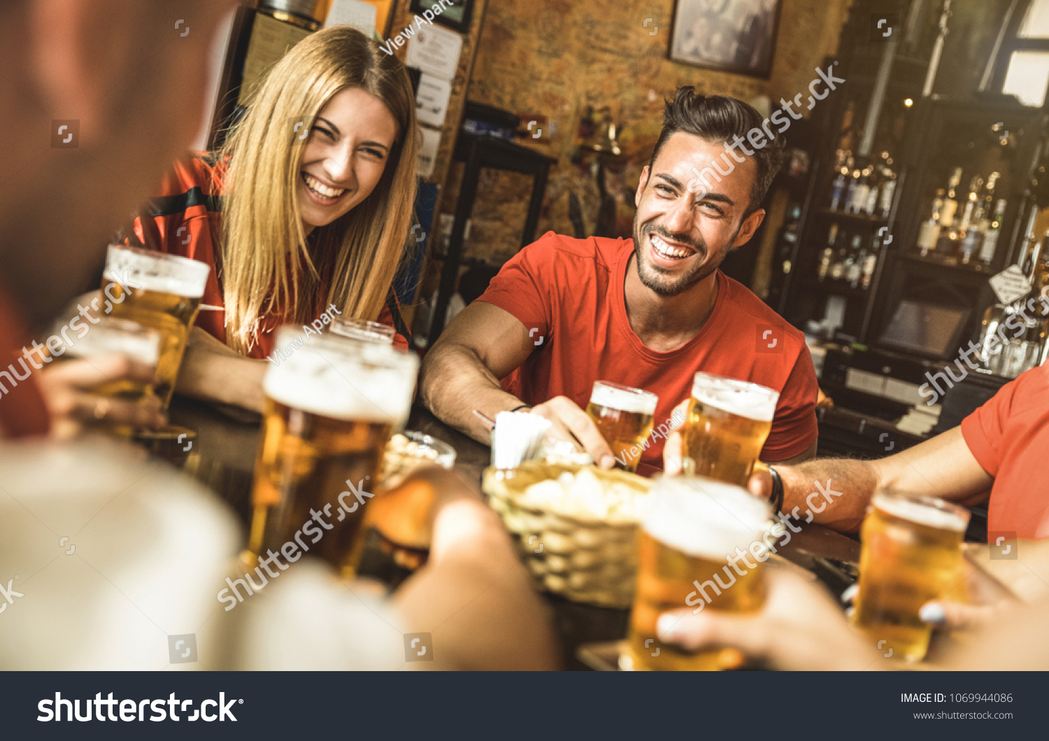 Happy friends group drinking beer at brewery bar restaurant - Friendship concept with young people enjoying time together and having genuine fun at cool vintage pub - Focus on guy - High iso image #1069944086