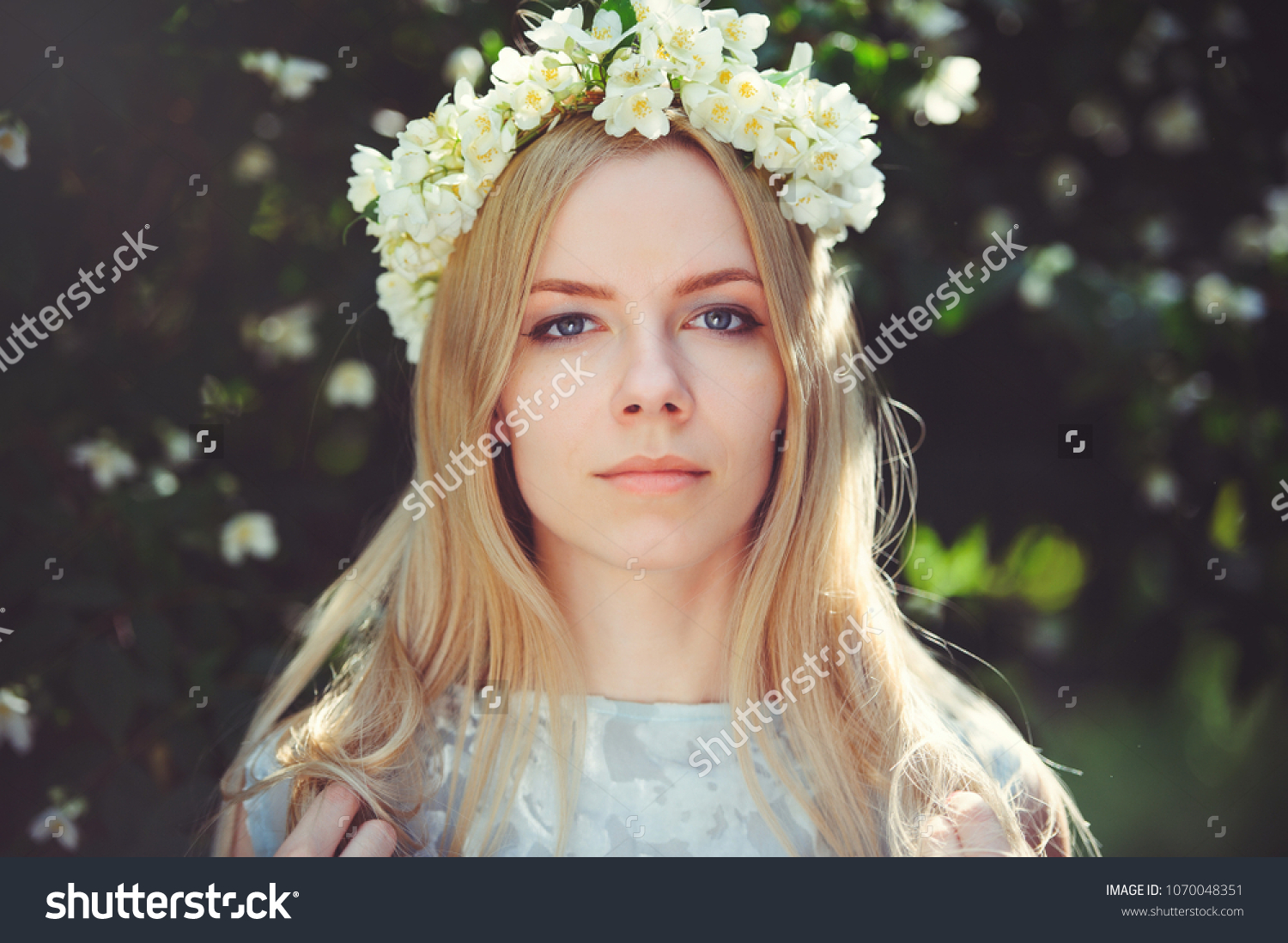 Attractive modest young girl blonde jasmine stock photo edit now attractive modest young girl with blonde with jasmine flowers wreath on head long hair and natural izmirmasajfo