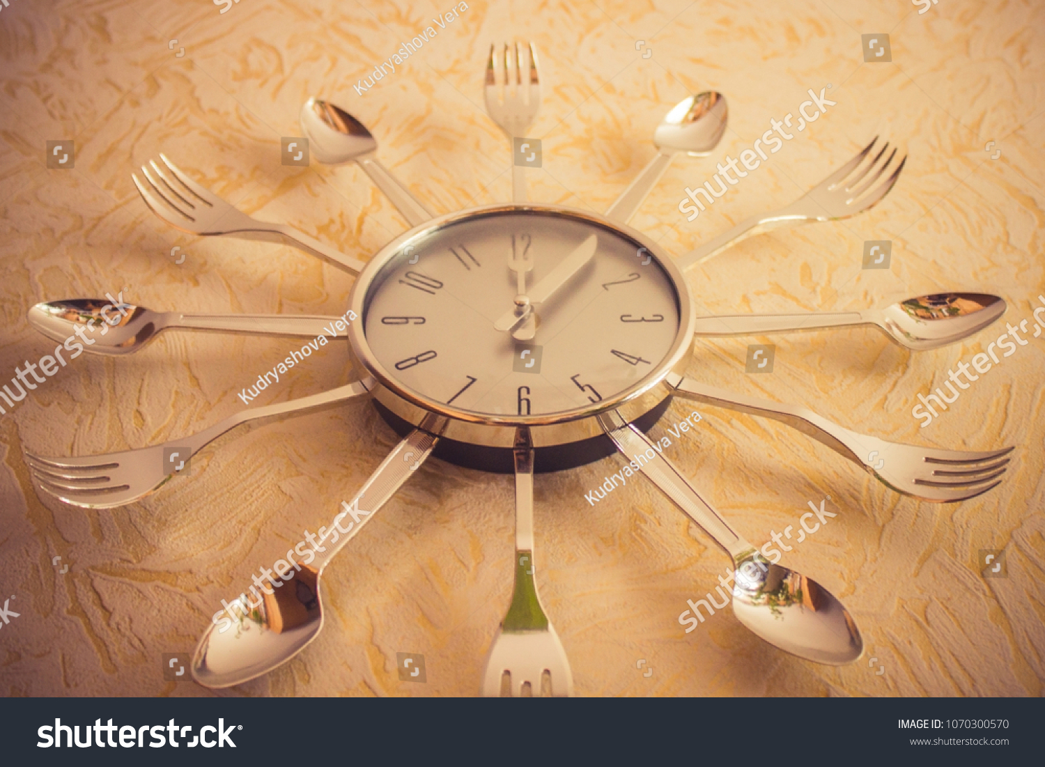 On Yellow Wall Metal Watch Arrows Stock Photo (Royalty Free ...