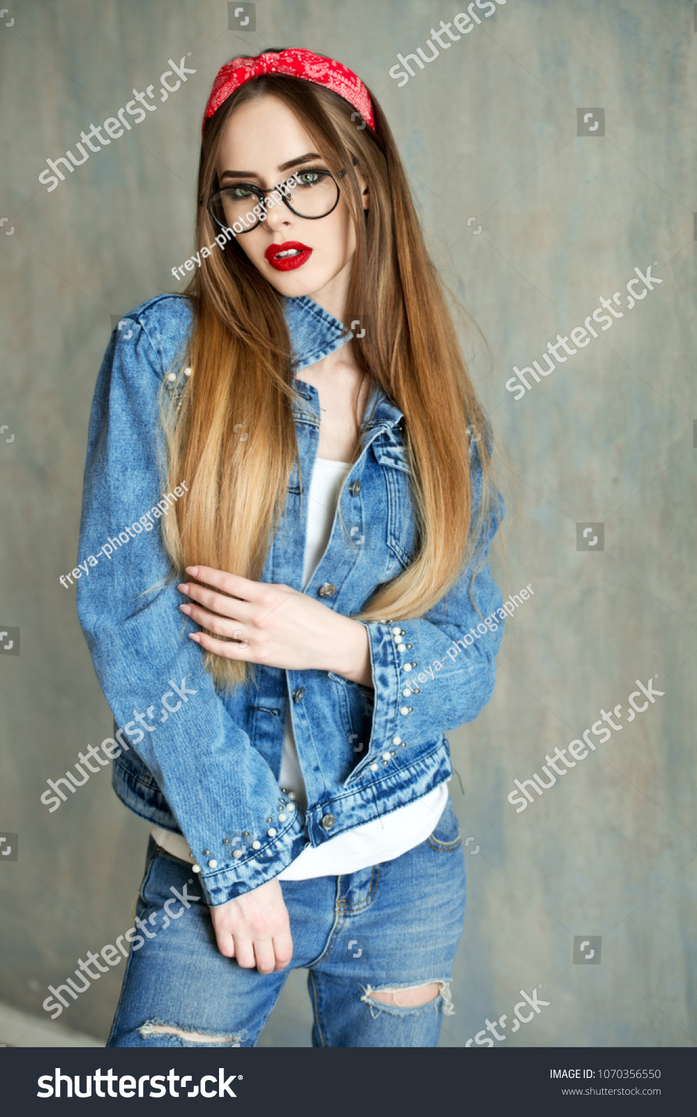 c9fa9af592 Beautiful woman in glasses and red bandana and jeans shirt. Beautiful girl  with pretty smile