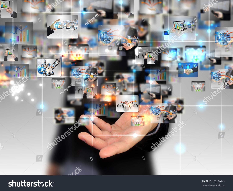 Technology Management Image: Businessman Holding Business World Stock Photo 107120741