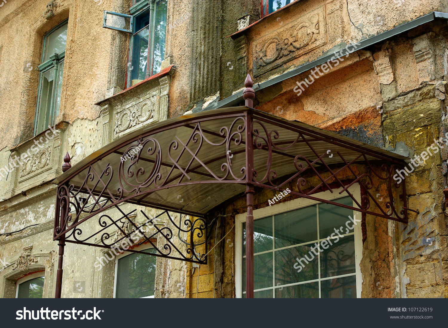 Old wroughtiron canopy over door old stock photo 107122619 for Tent over house