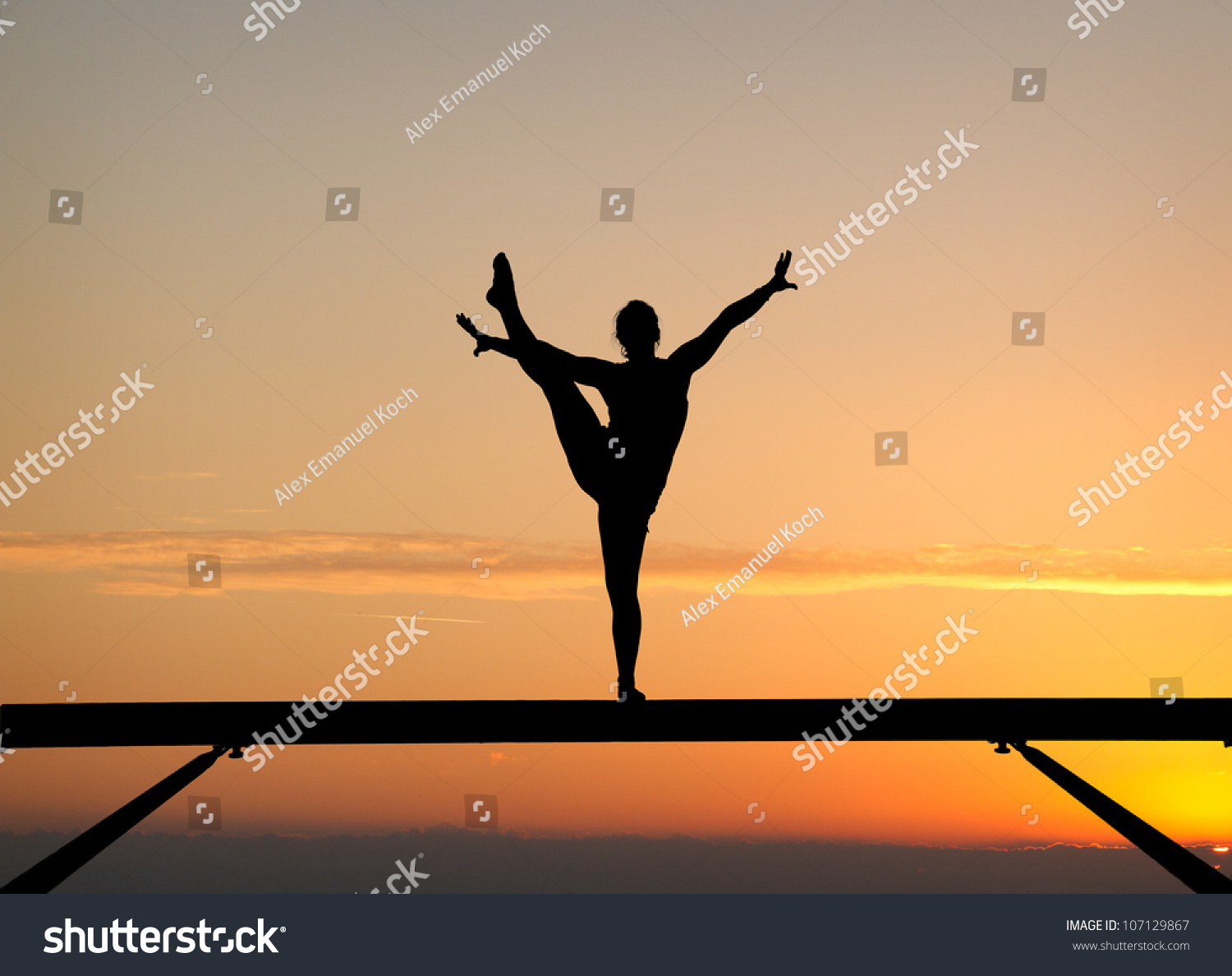 Silhouette Female Gymnast On Balance Beam Stock Photo