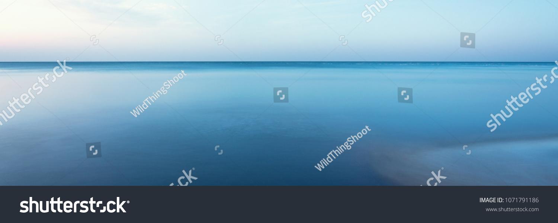 horizontal line of calm sea on the day light #1071791186