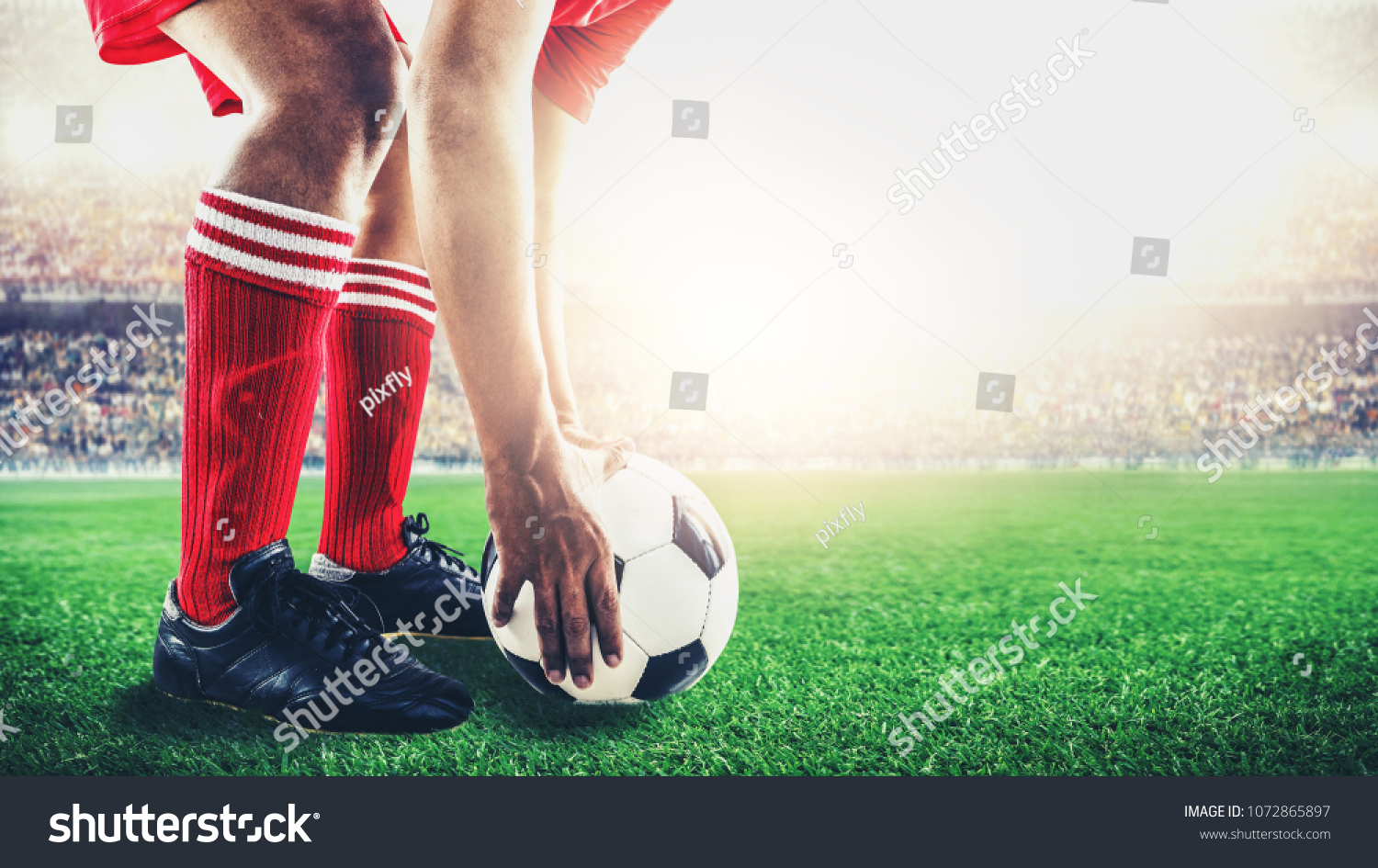 red team soccer footballer get the ball to free kick or penalty kick during match in the stadium #1072865897