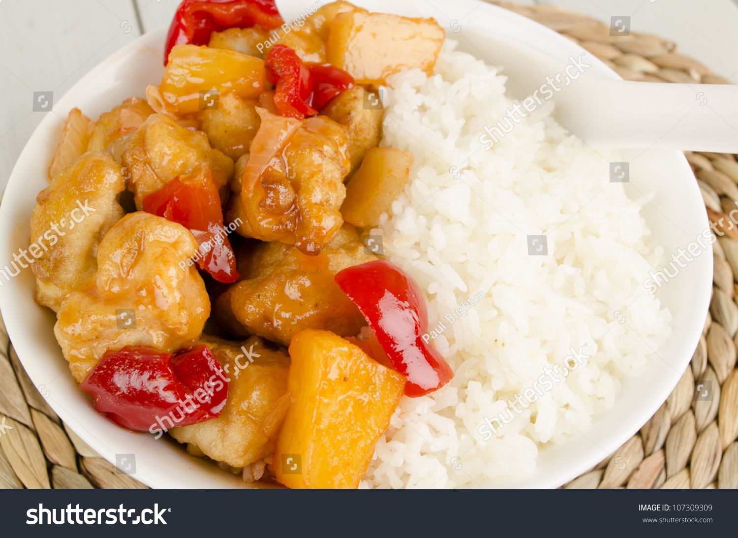 Sweet and Sour Chicken with pineapple and red bell peppers served with ...