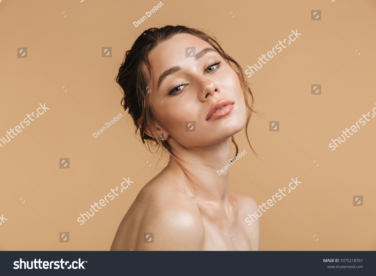 Image of young pure beautiful gentle woman standing naked isolated looking  camera.