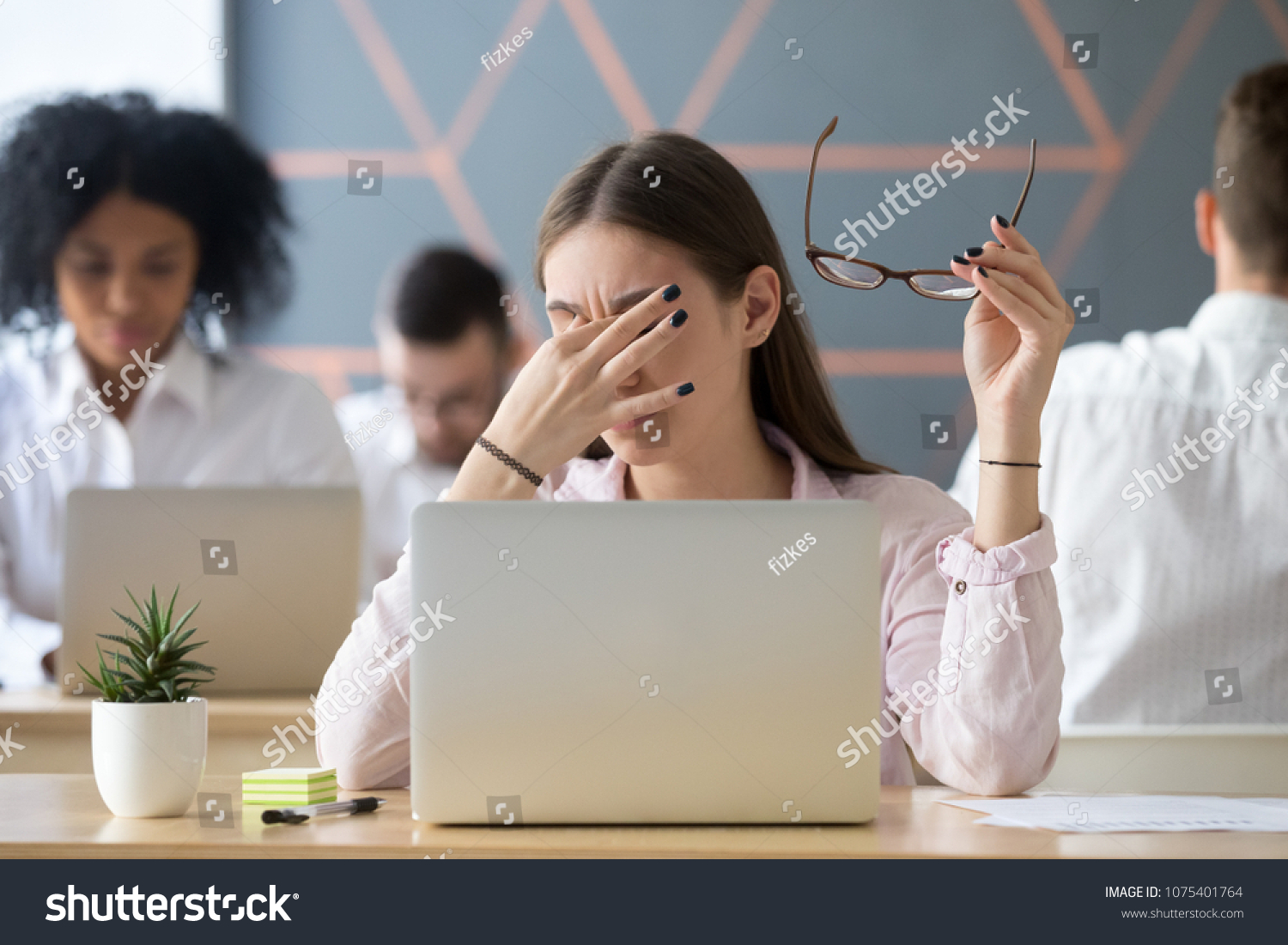 Young woman taking off glasses tired of computer work, exhausted student or employee suffering from eye strain tension or computer blurry vision problem after long laptop use, eyes fatigue concept