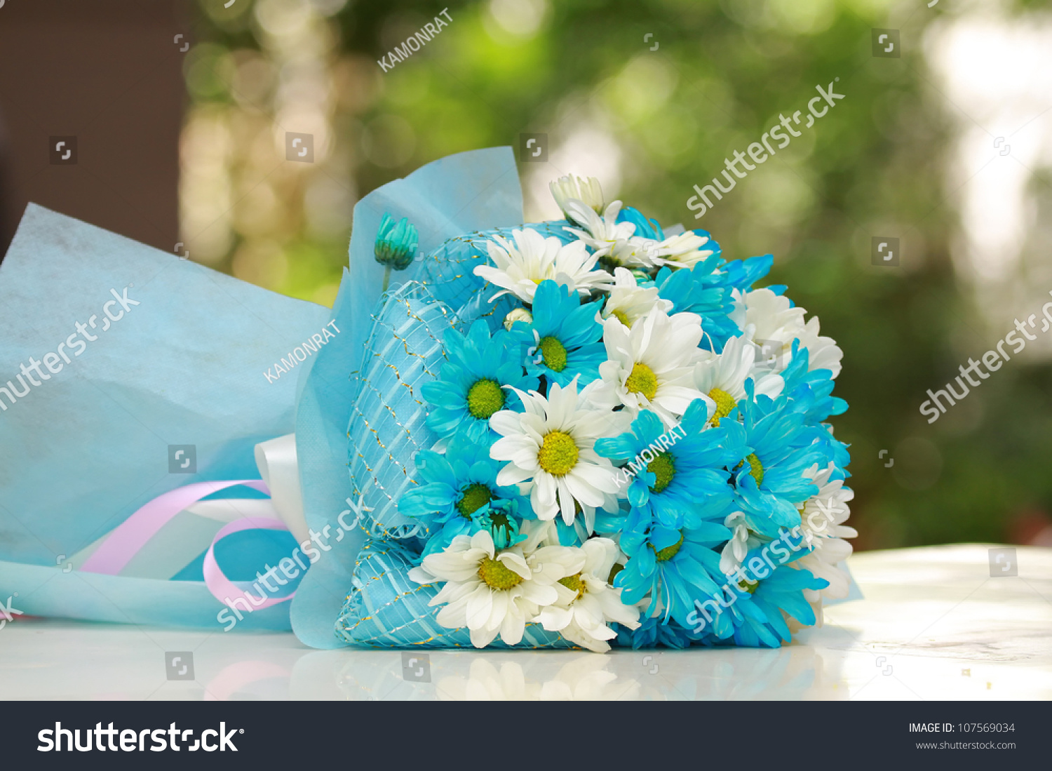 Beautiful Bouquet Of Bright Blue And White Flowers On Table Green Background