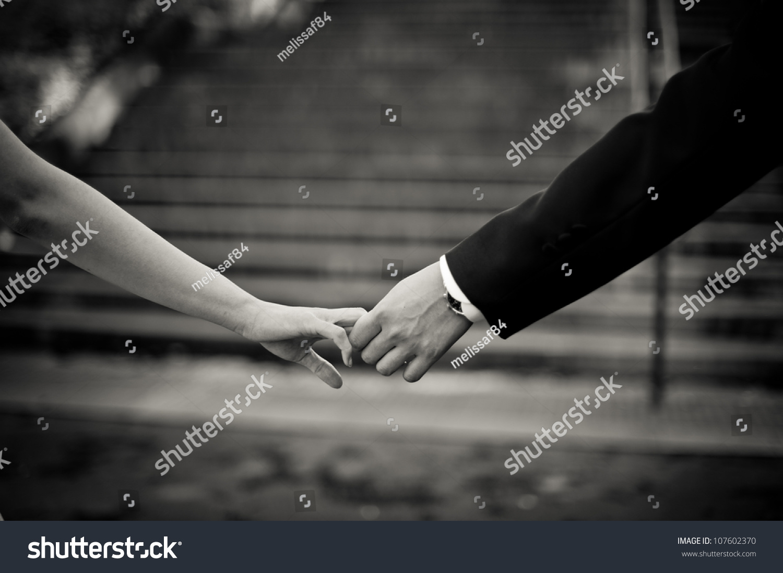Man Woman Holding Hands Stock Photo 107602370 - Shutterstock