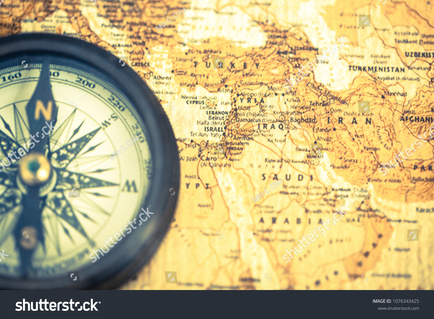 Old compass on vintage world map stock photo edit now 1076343425 an old compass on vintage world map compass on map background close up gumiabroncs Choice Image