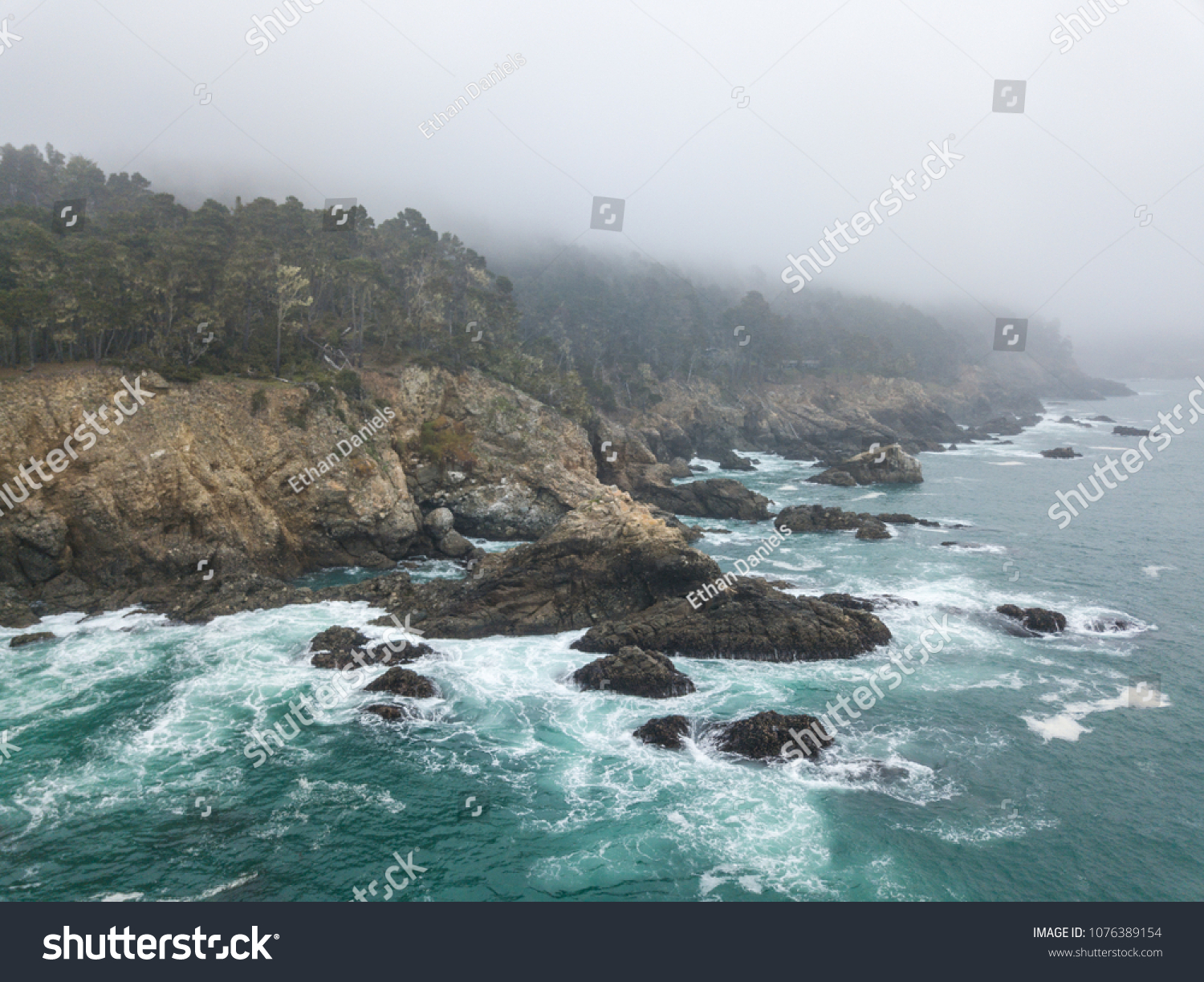 The cold waters of the Pacific Ocean wash against the rocky northern California coastline in Sonoma. This scenic region, north of San Francisco, is accessible via the famous highway one. #1076389154