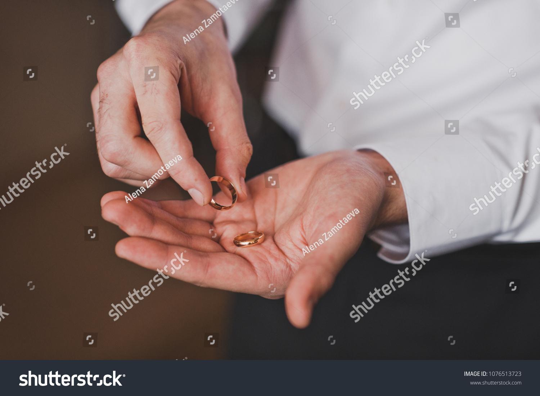 Gold Rings Spouses Hands Men Stock Photo Edit Now 1076513723