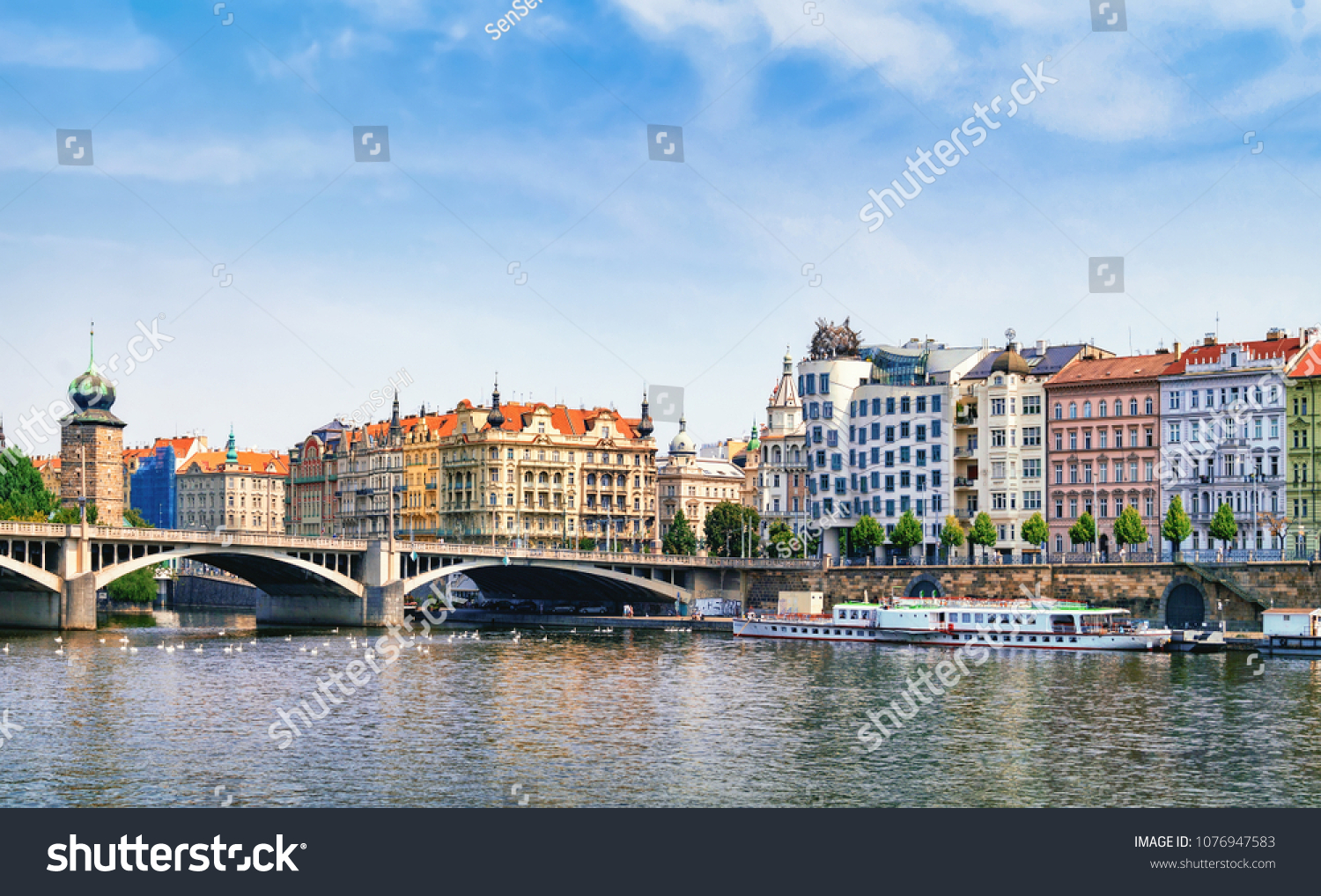 PRAGUE, CZECH REPUBLIC - AUGUST 9, 2015: Vltava view with Dancing House at right #1076947583