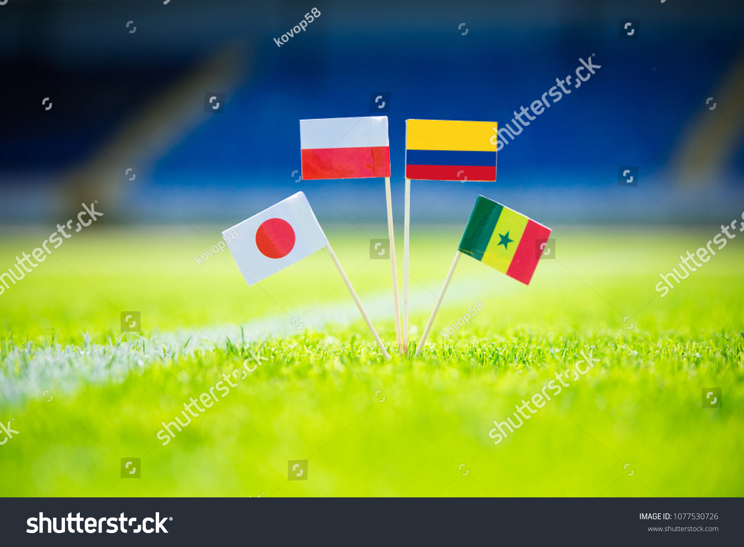 GROUP H draw in Russia 2018  - Poland, Senegal, Columbia, Japan national Flag and football ball on green grass. Fans, support photo, edit space. Original wallpaper for Football World Cup, Russia 2018 #1077530726