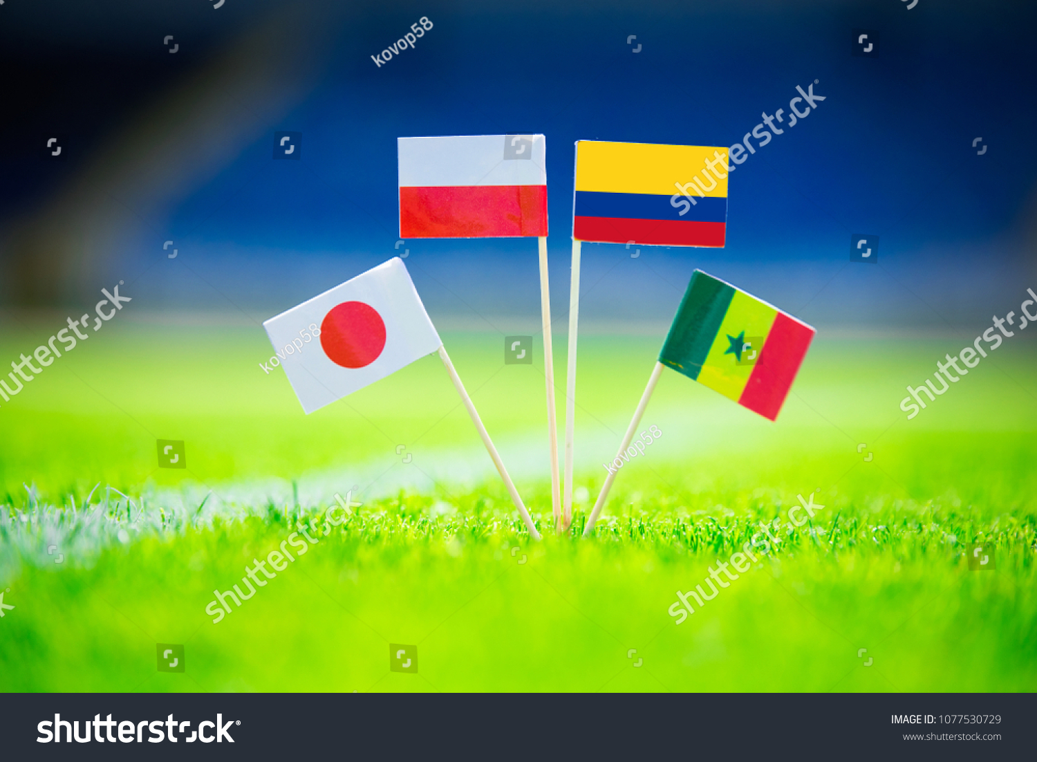 GROUP H draw in Russia 2018  - Poland, Senegal, Columbia, Japan national Flag and football ball on green grass. Fans, support photo, edit space. #1077530729