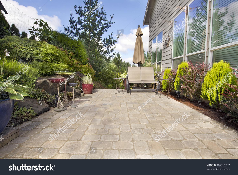 garden backyard paver patio chairs umbrella stock photo 107760737
