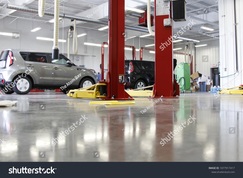 Lift Mechanic Perform Oil Change On Stock Photo (Edit Now) 1077917417