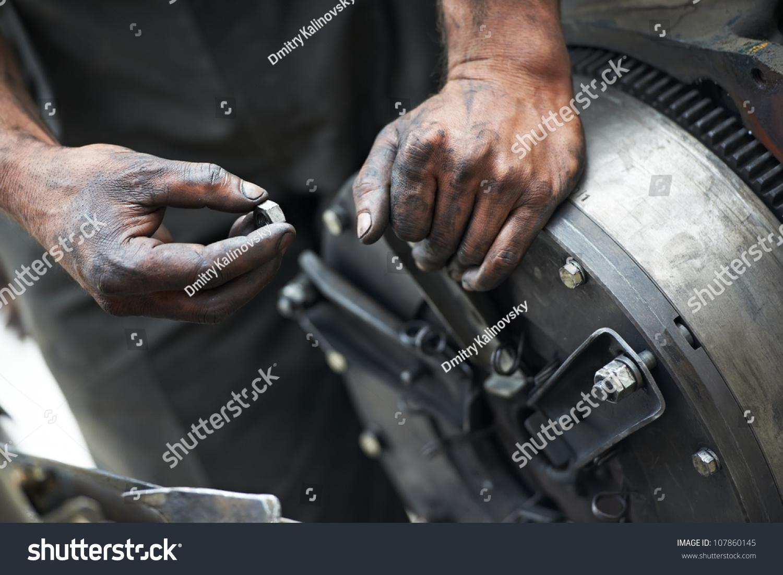 dirty car mechanic hands examining car stock photo 107860145 shutterstock. Black Bedroom Furniture Sets. Home Design Ideas