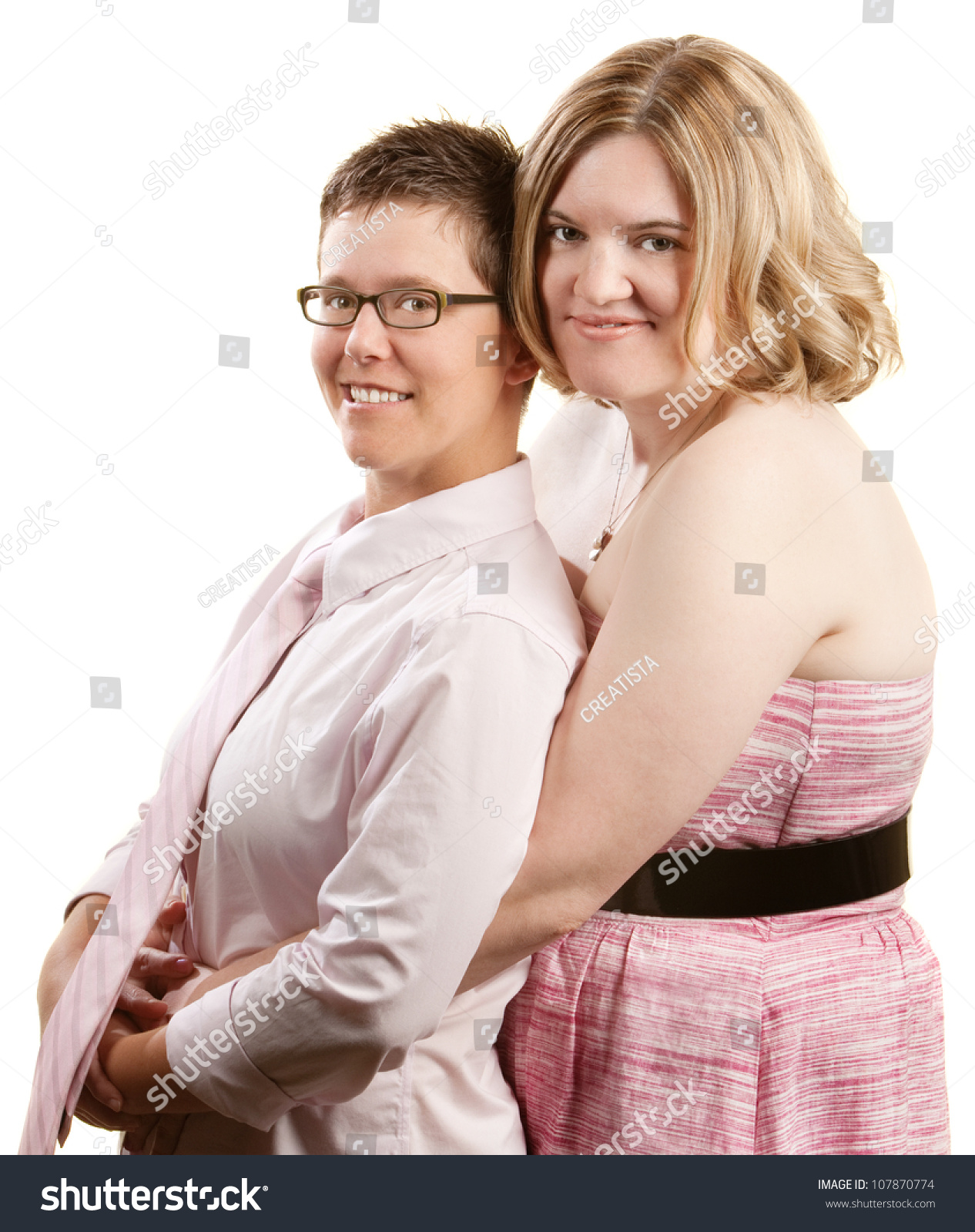 Caucasian Lesbian Couple Embracing Over White Background