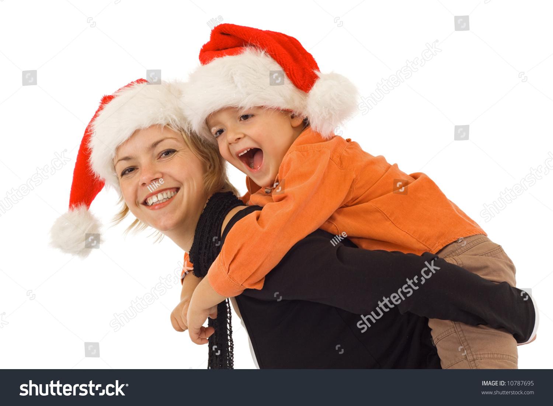 de7761a04fd Woman And Little Boy Playing In Santa Hats - Studio Shot .