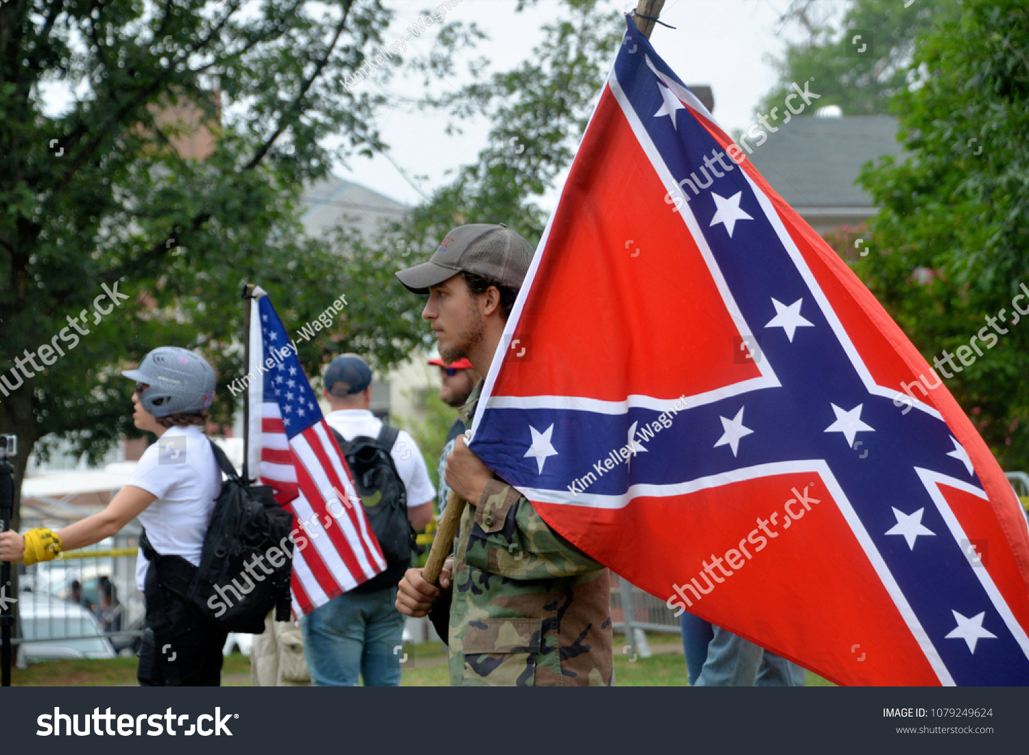 """""""Dear God, please help me to hate white people."""" Stock-photo-charlottesville-va-august-members-of-a-white-supremacist-group-at-a-white-nationalist-1079249624"""
