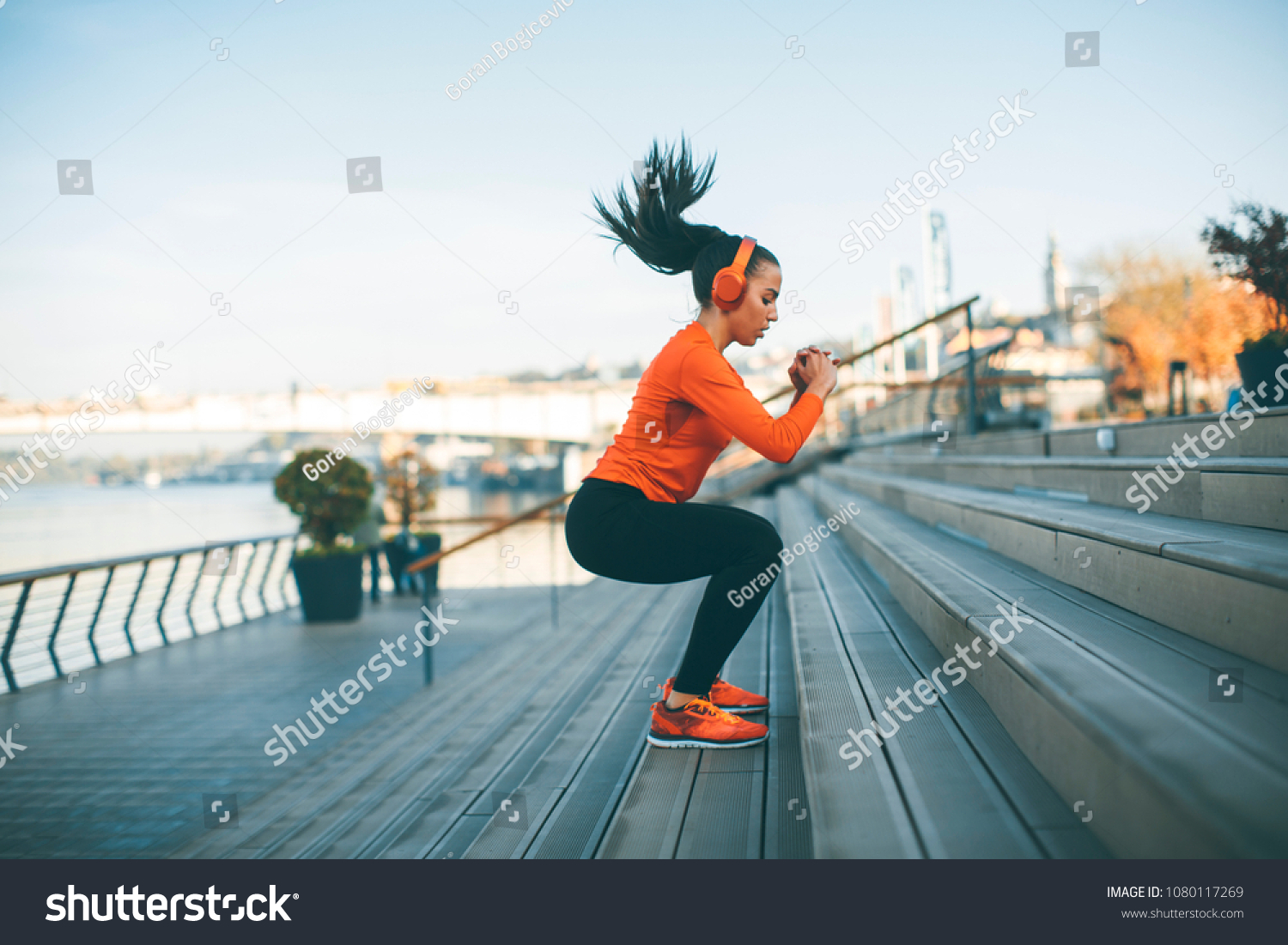 Fitness woman jumping outdoor in urban enviroment #1080117269