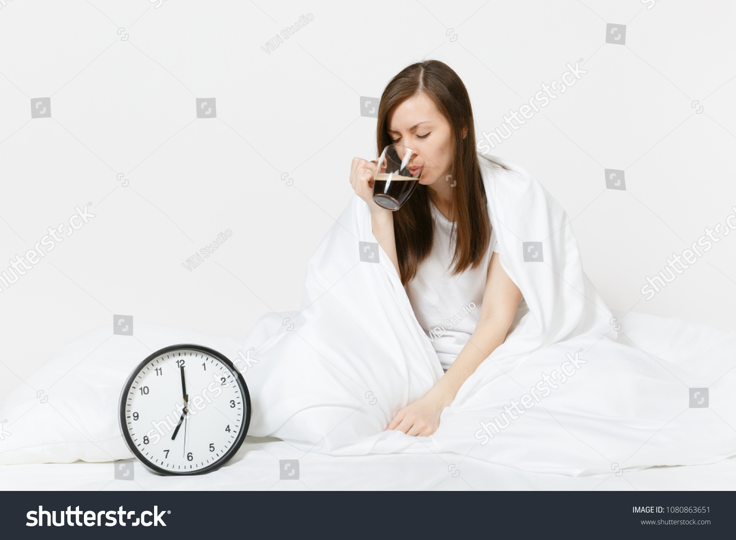 beautiful happy with sitting on in bed woman head up photo royalty sleeping lying free for asian pillow comfortable young stock