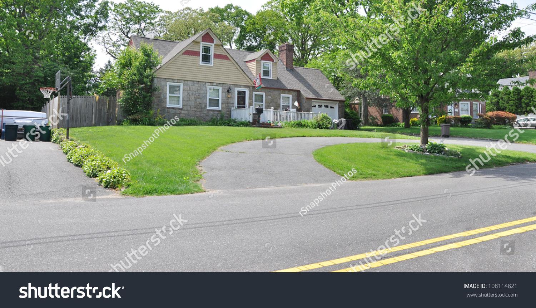 Half circle blacktop driveway suburban stone stock photo for Half circle driveway design