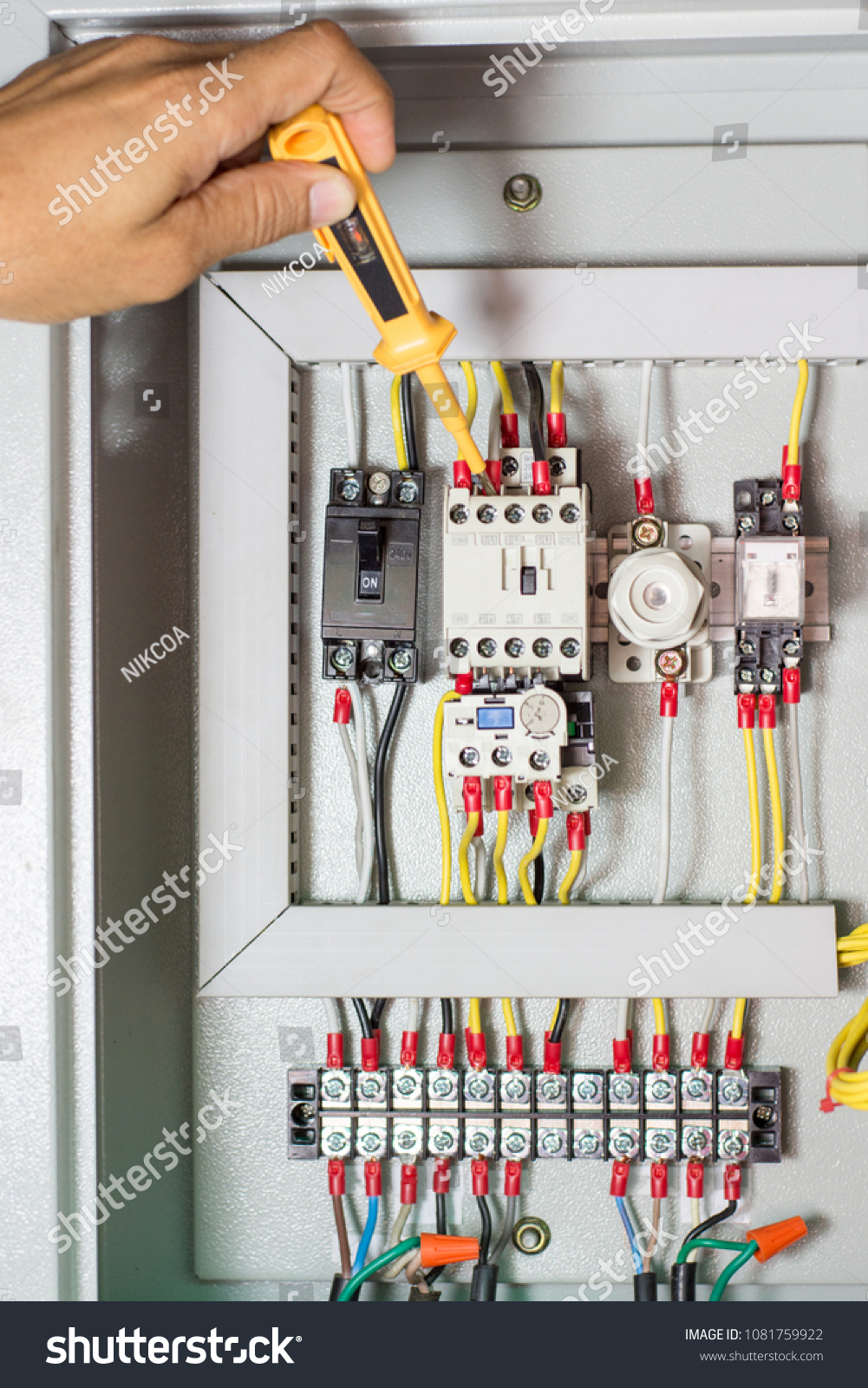 Electrician Checking Current Circuit Magnetic Contactor Stock Photo How To Test Electrical Circuits At In Control Terminal Box With Screwdriver Lamp