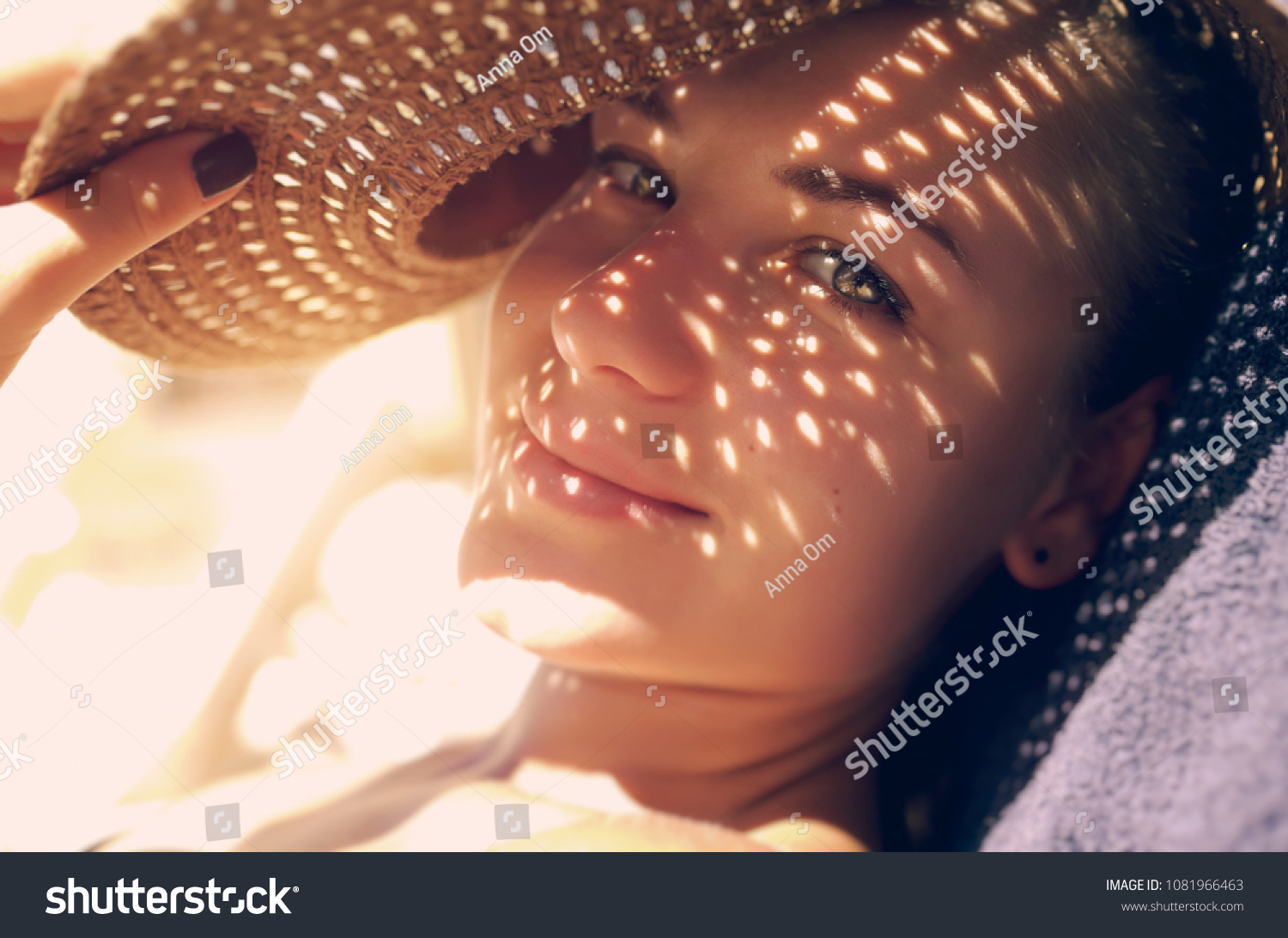 Pretty woman on the beach, closeup portrait of a nice female hides her face from the sun under a straw hat, skin protection, happy healthy summer vacation                                #1081966463 - 123PhotoFree.com