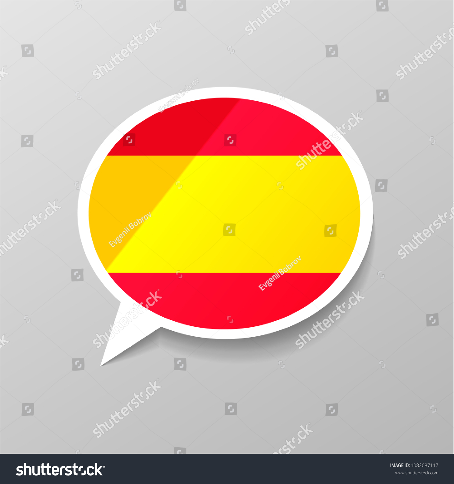 Bright glossy sticker in speech bubble shape with spain flag spanish language concept on gray