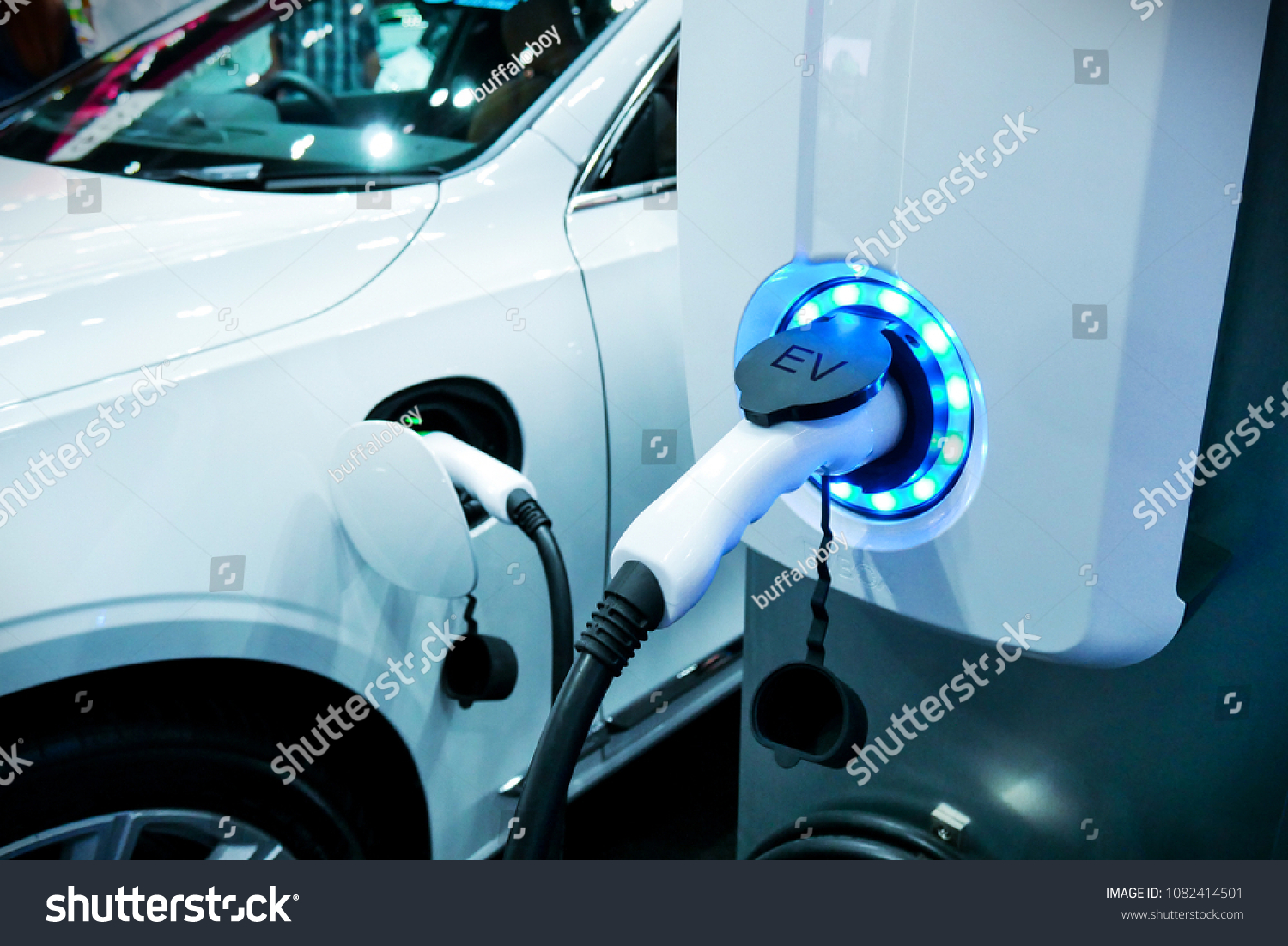 Power supply connect to electric vehicle for charge to the battery. Charging technology industry transport which are the futuristic of the Automobile. EV fuel Plug in hybrid car. #1082414501