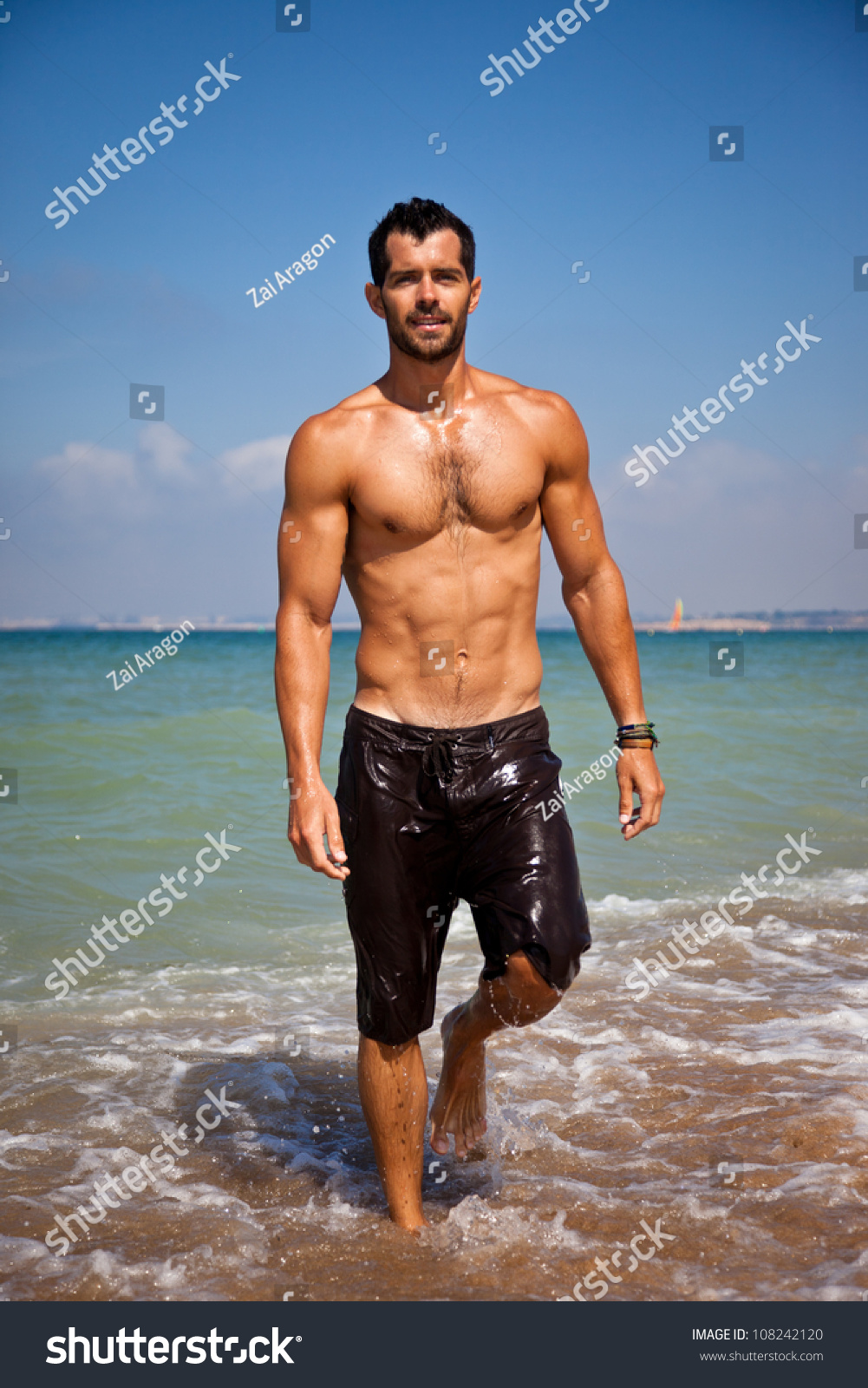 Handsome Muscular Man Walking Out Of The Water On A ...