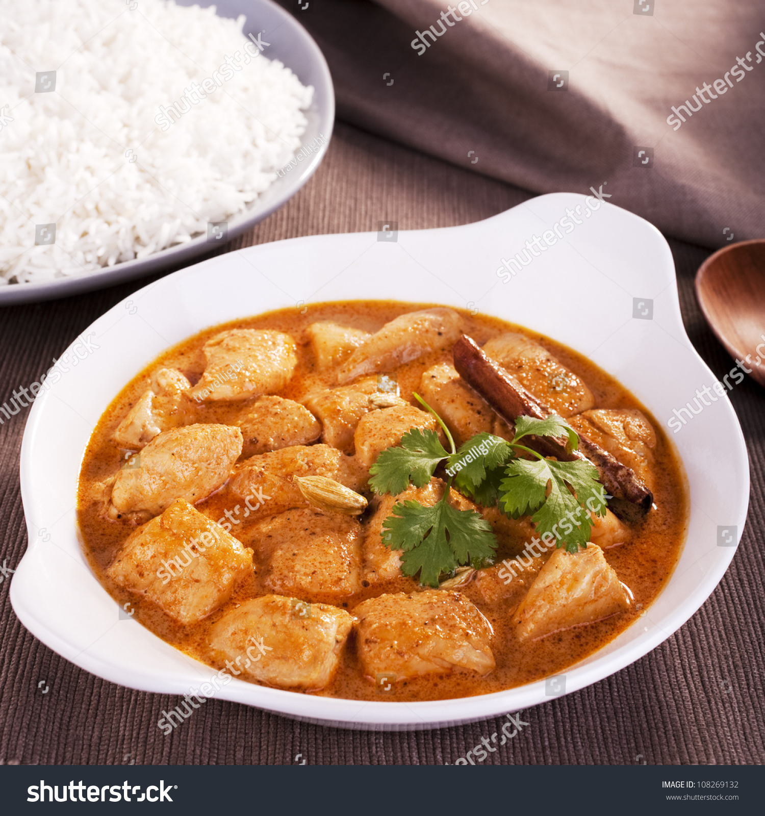 Indian favourite curry, butter chicken, garnished with coriander ...