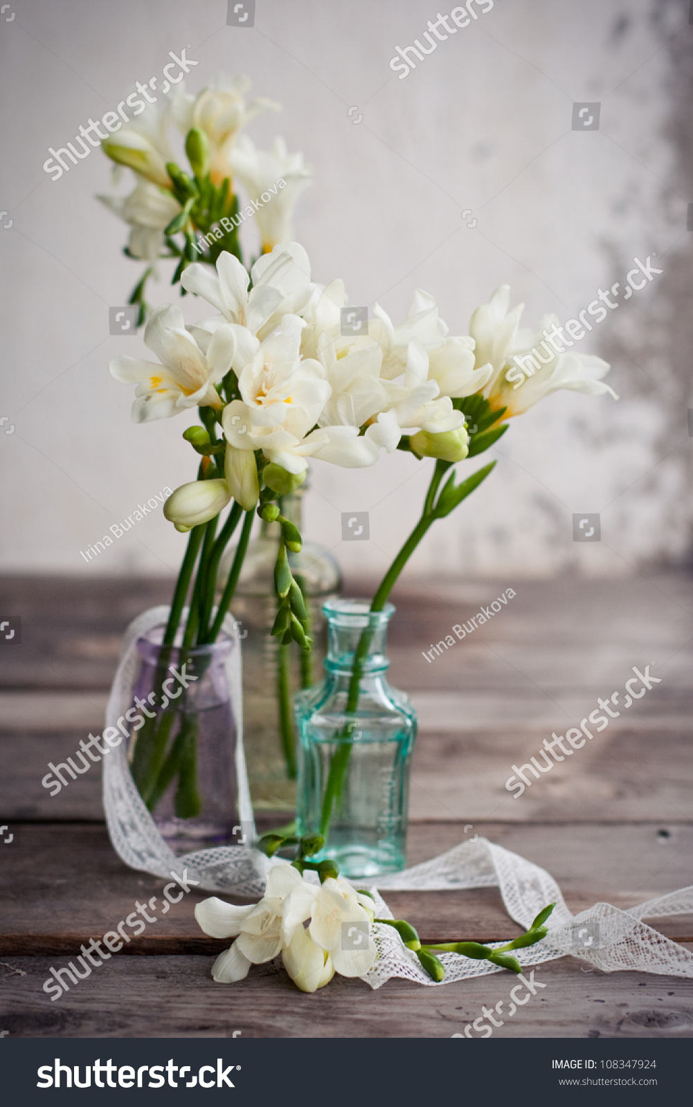 Royalty Free White Freesia Flowers In Decorative 108347924 Stock