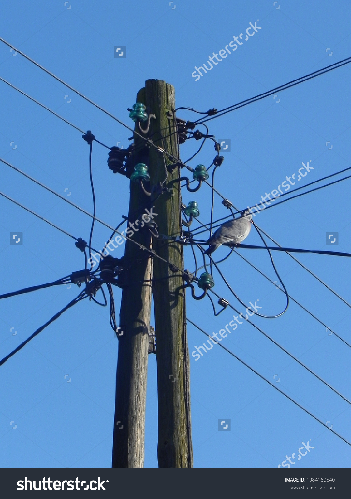 Vintage Old Fashioned Electric Pole Against Stock Photo (Royalty ...