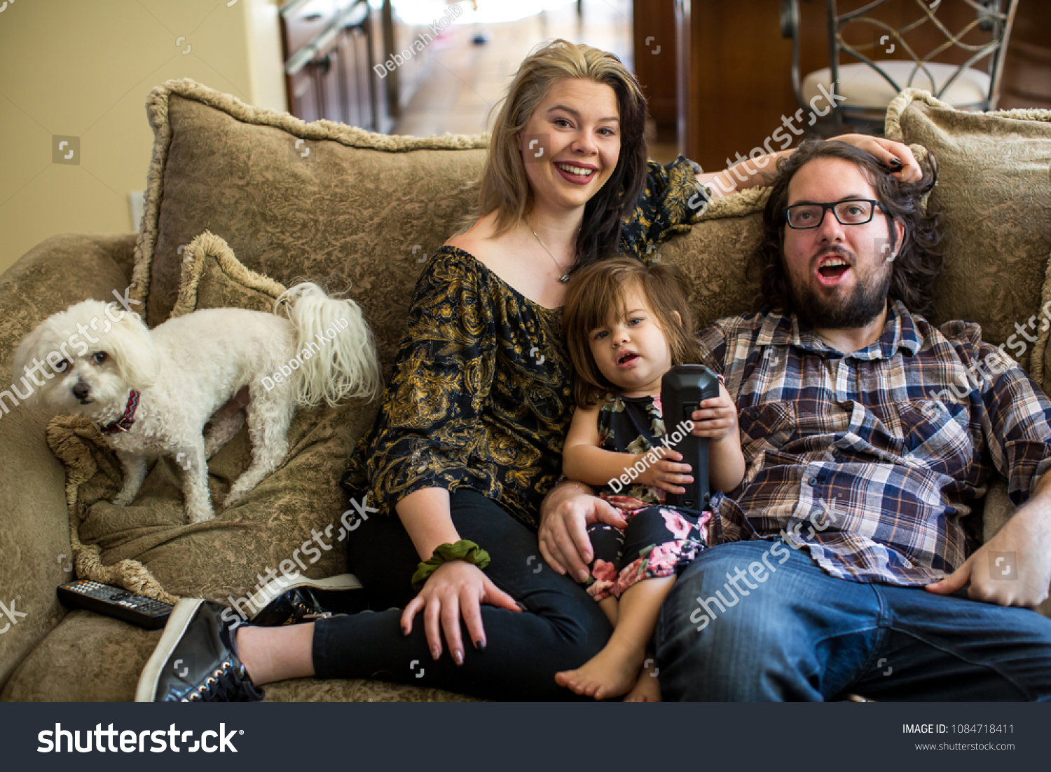 A Funny Family Portrait With Their Dog