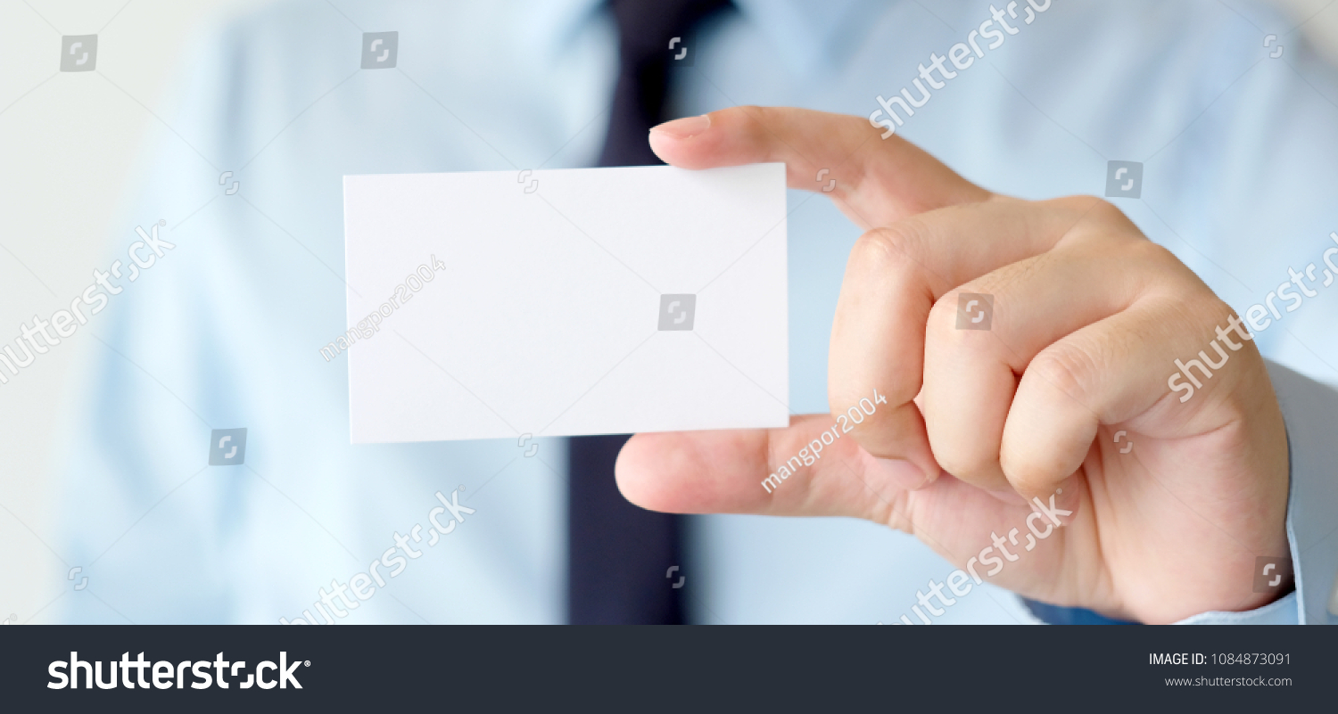 Professional company print business card background, Business man hand holding blank white paper for the professional company print card background, banner, template, mockup #1084873091