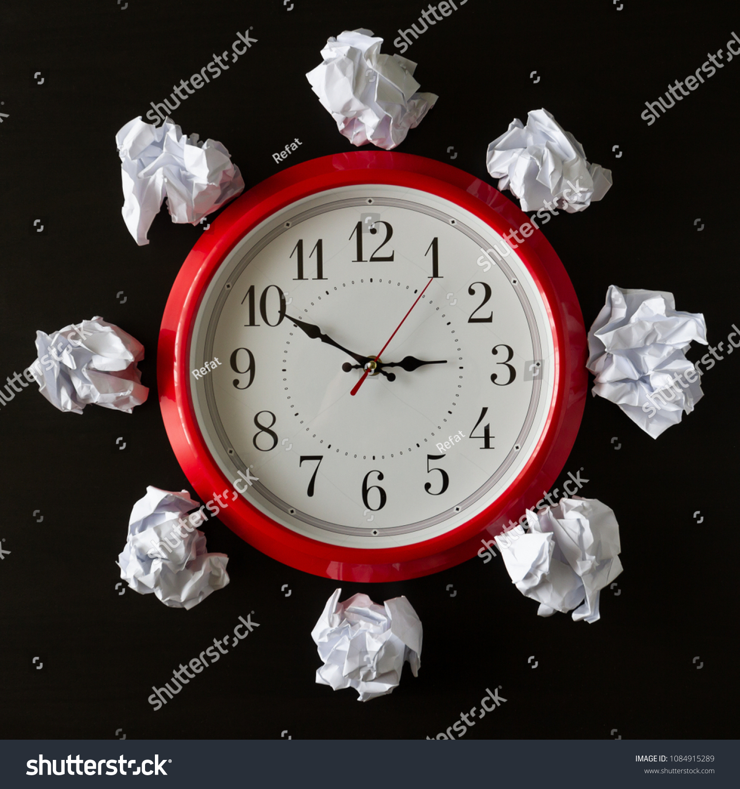round clock red frame crumpled sheets stock photo edit now