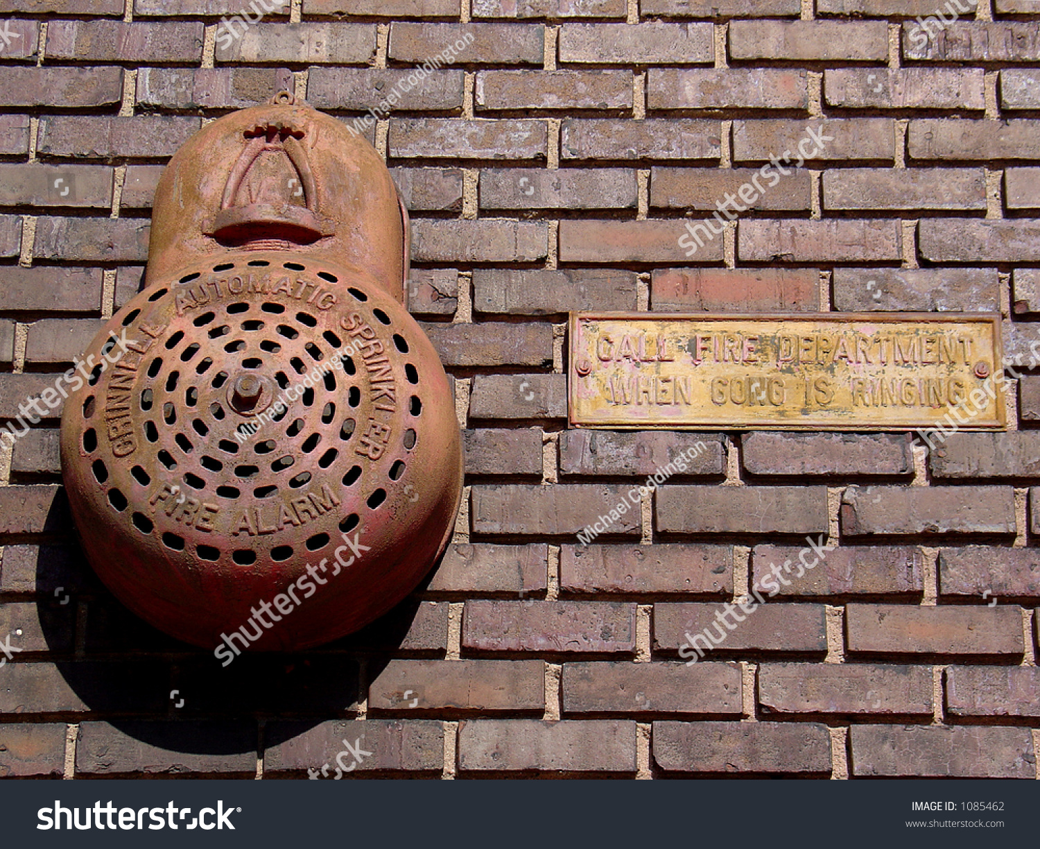 Old Fire Brick : Antique fire alarm gong sign on stock photo