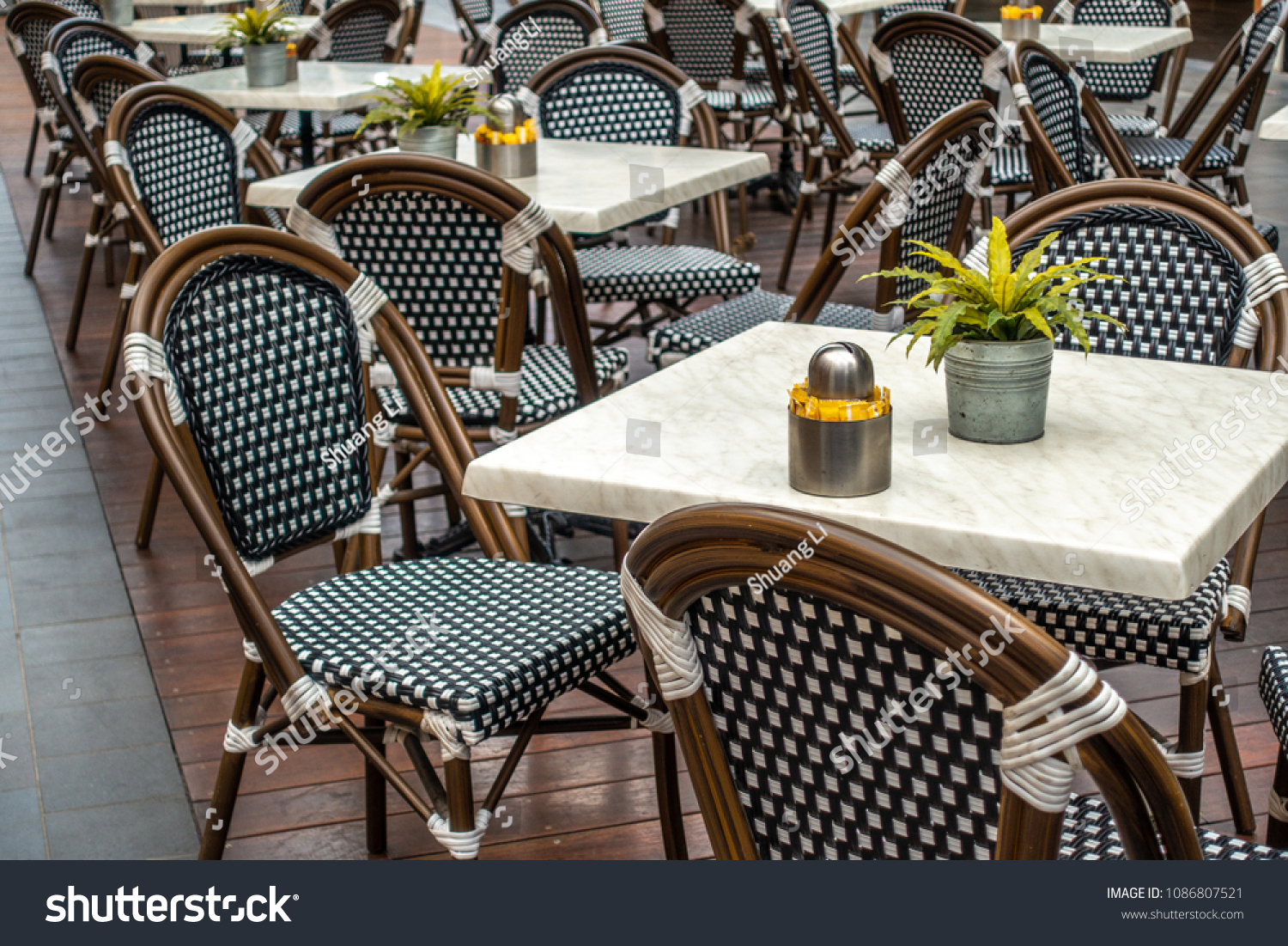 Restaurant table and chairs settings in outdoor dinning area elegant chair with stylish marble surface tabletop