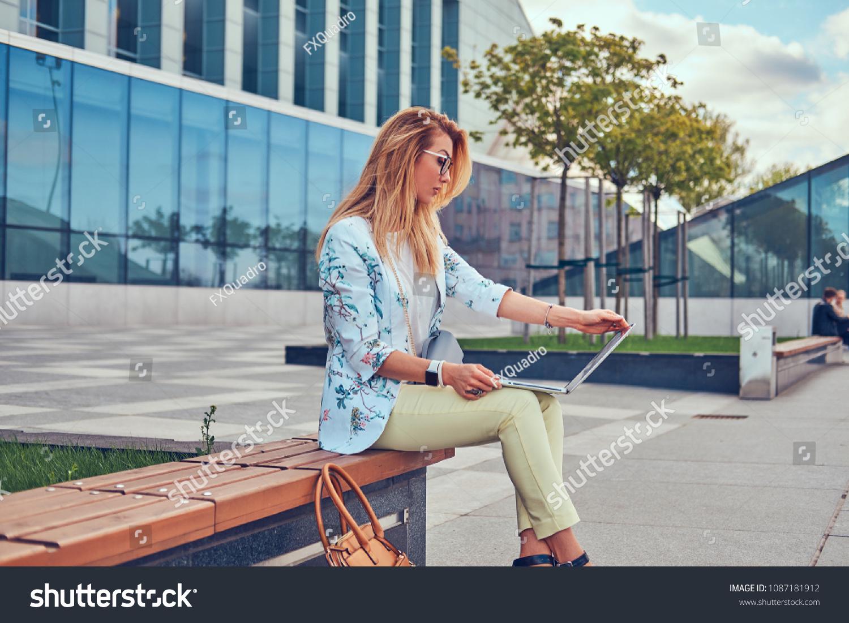 Stylish fashion ger using laptop work stock photo edit now
