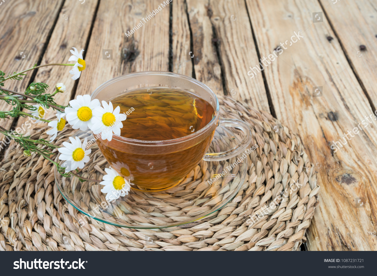 Cup with hot infusion of chamomile