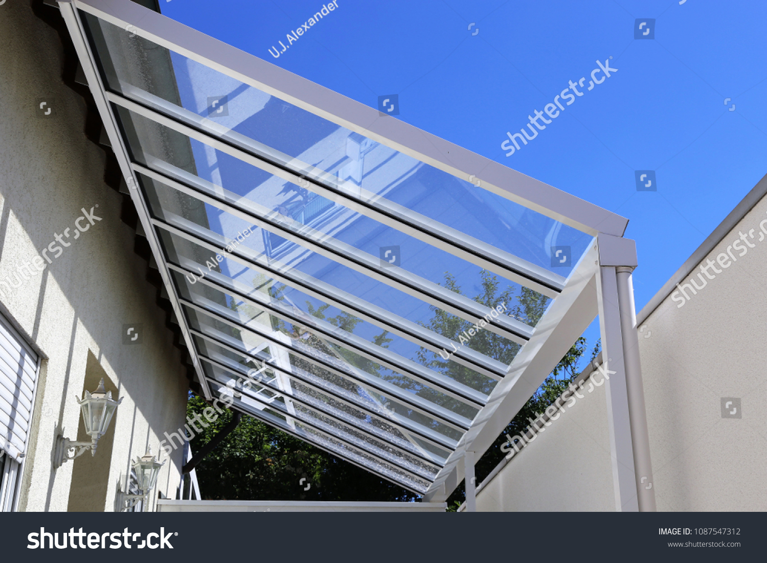 Courtyard canopy with glass #1087547312