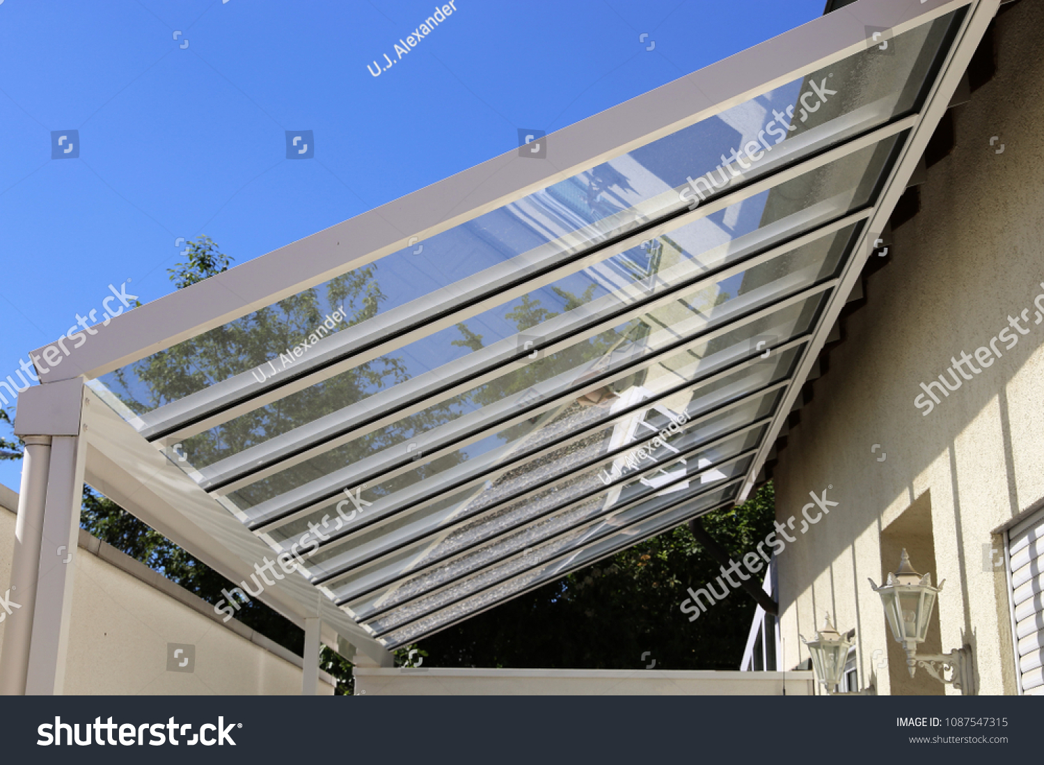 Courtyard canopy with glass #1087547315