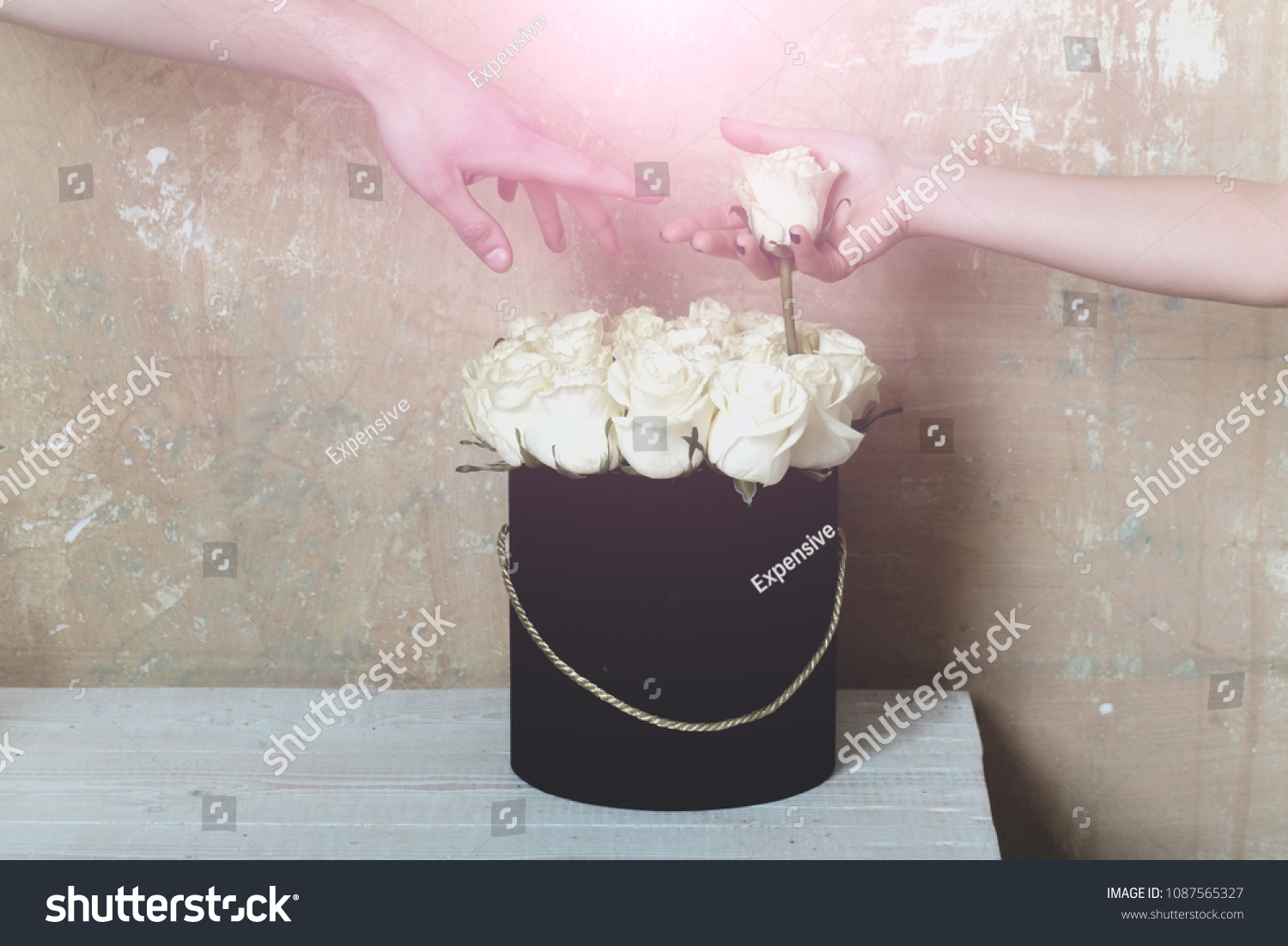 Roses hands beautiful bouquet loving couple stock photo royalty roses and hands a beautiful bouquet and a loving couple beautiful flowers for the izmirmasajfo