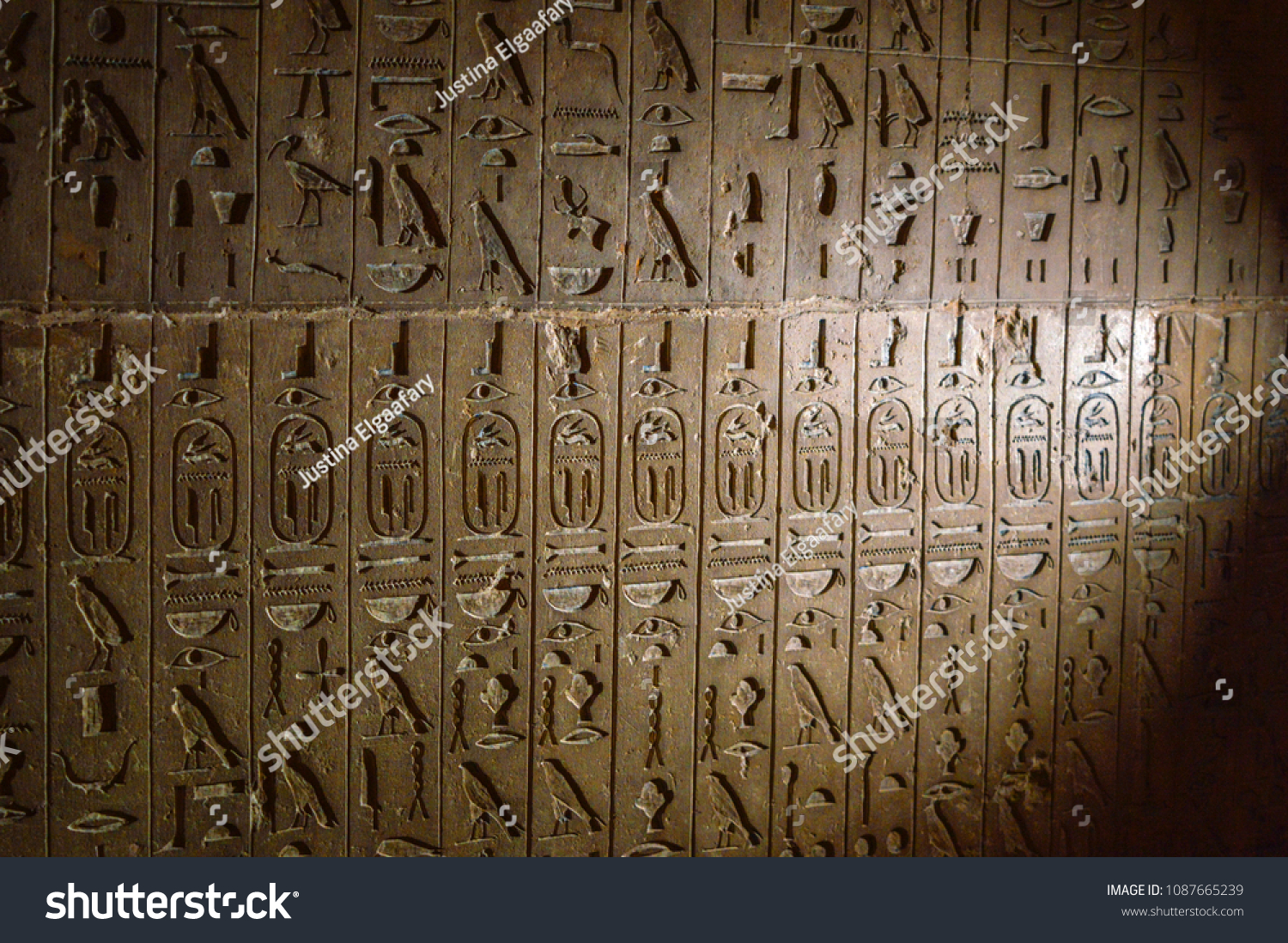 Wall carved ancient egyptian hieroglyphs repeated stock photo