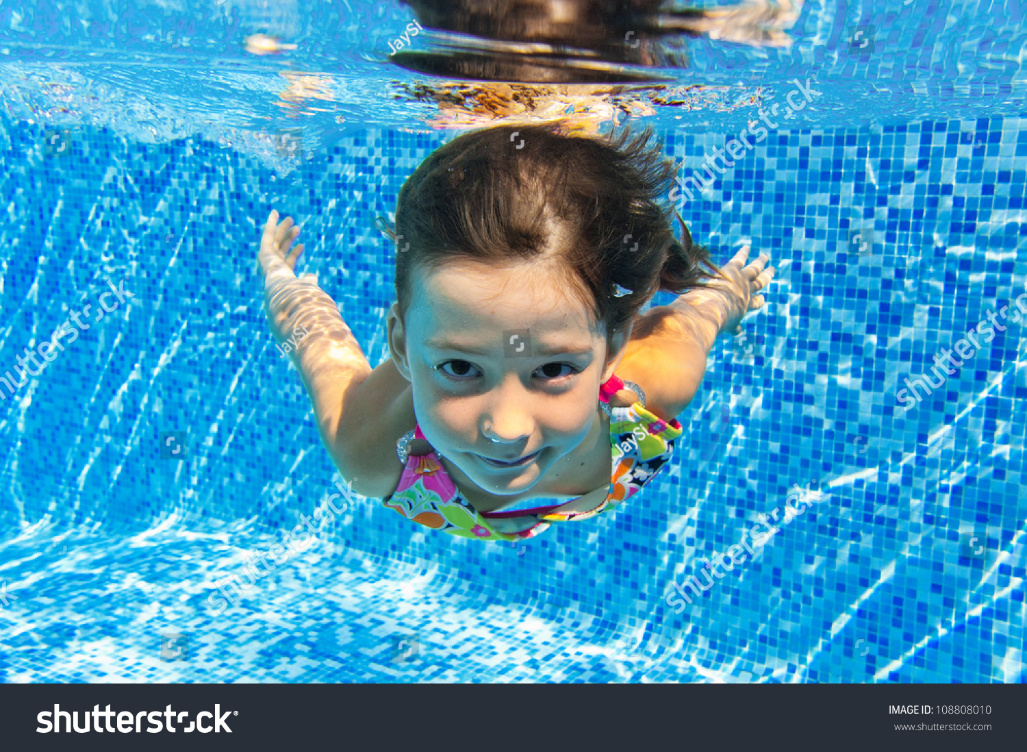 Happy smiling underwater child swimming pool stock photo - Swimming pool girl christmas vacation ...